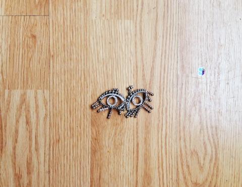 My kitschy eye earrings from  H&M . to add a little interest.