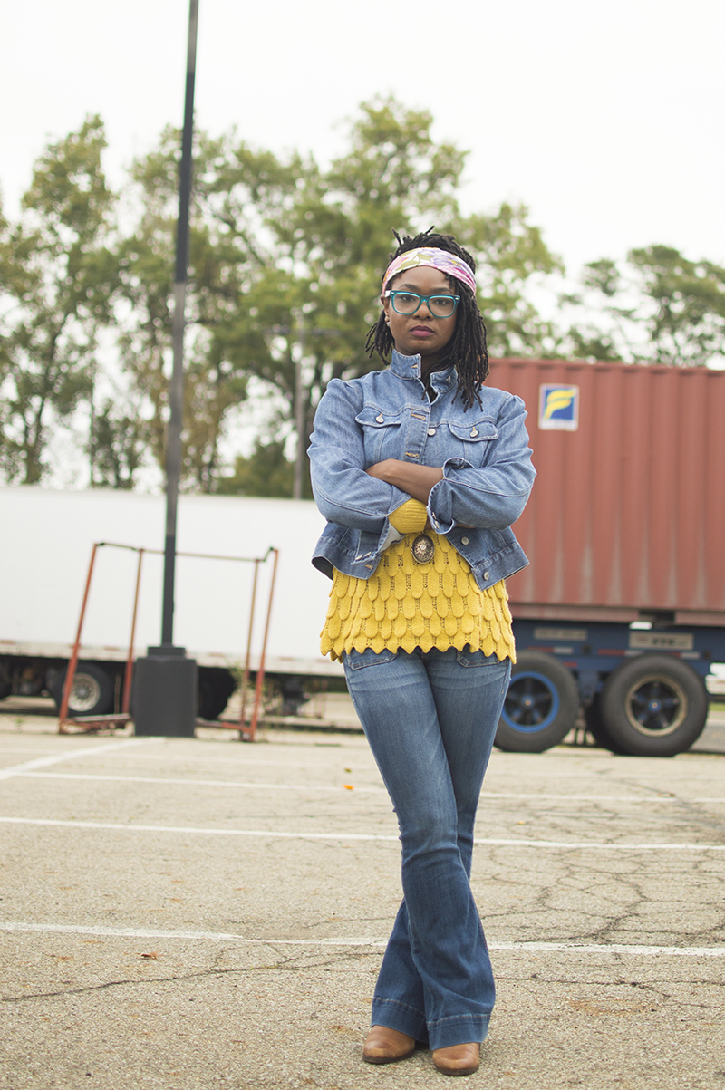 Denim on denim broken up by a mustard yellow scalloped sweater. 70's style for fall.