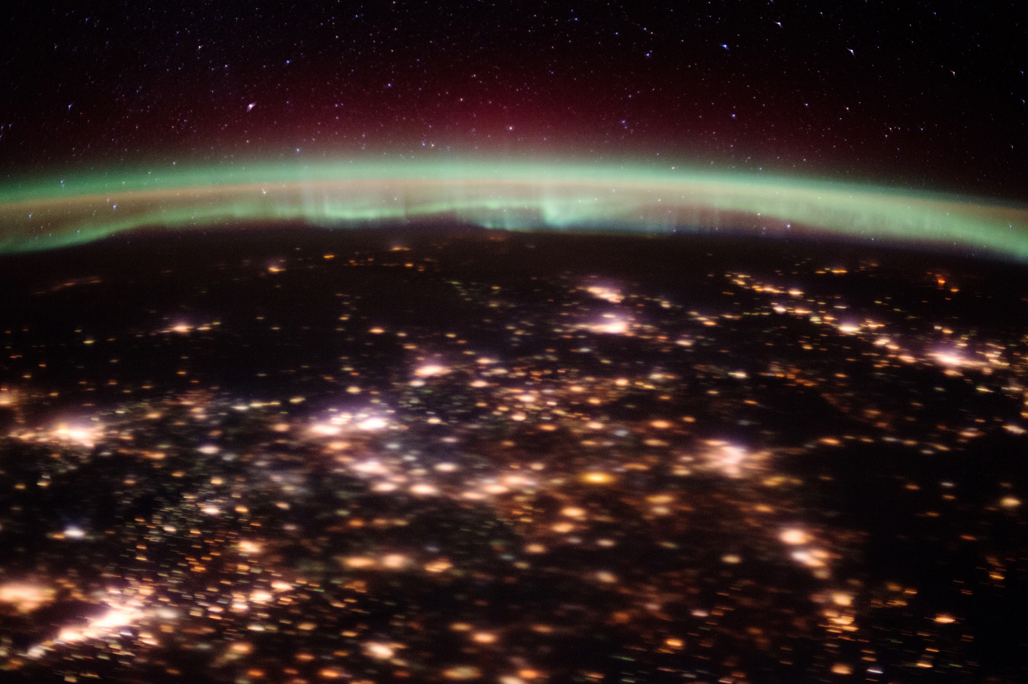 The Northern Lights as recorded by the ISS astronauts over the night lights of northern Europe in February 2016. Courtesy of NASA.