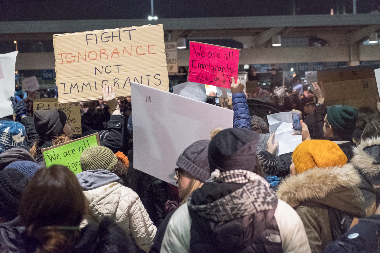 Protesters Saturday night at John F. Kennedy Airport in New York City welcome immigrants following the Executive Order by the Trump Administration. Photo courtesy of  Luminary Traveler  of the Flickr Creative Commons.