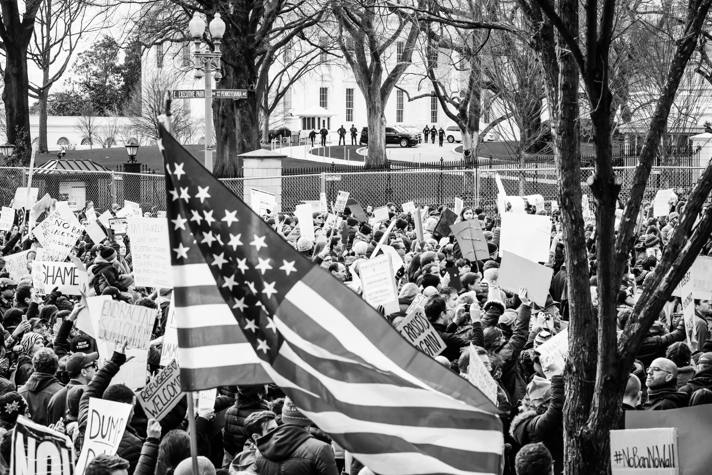 Protesters outside The White House stand up against Trump's Executive Order. Photo Courtesy of  Geoff Livingston  of the Flickr Creative Commons.