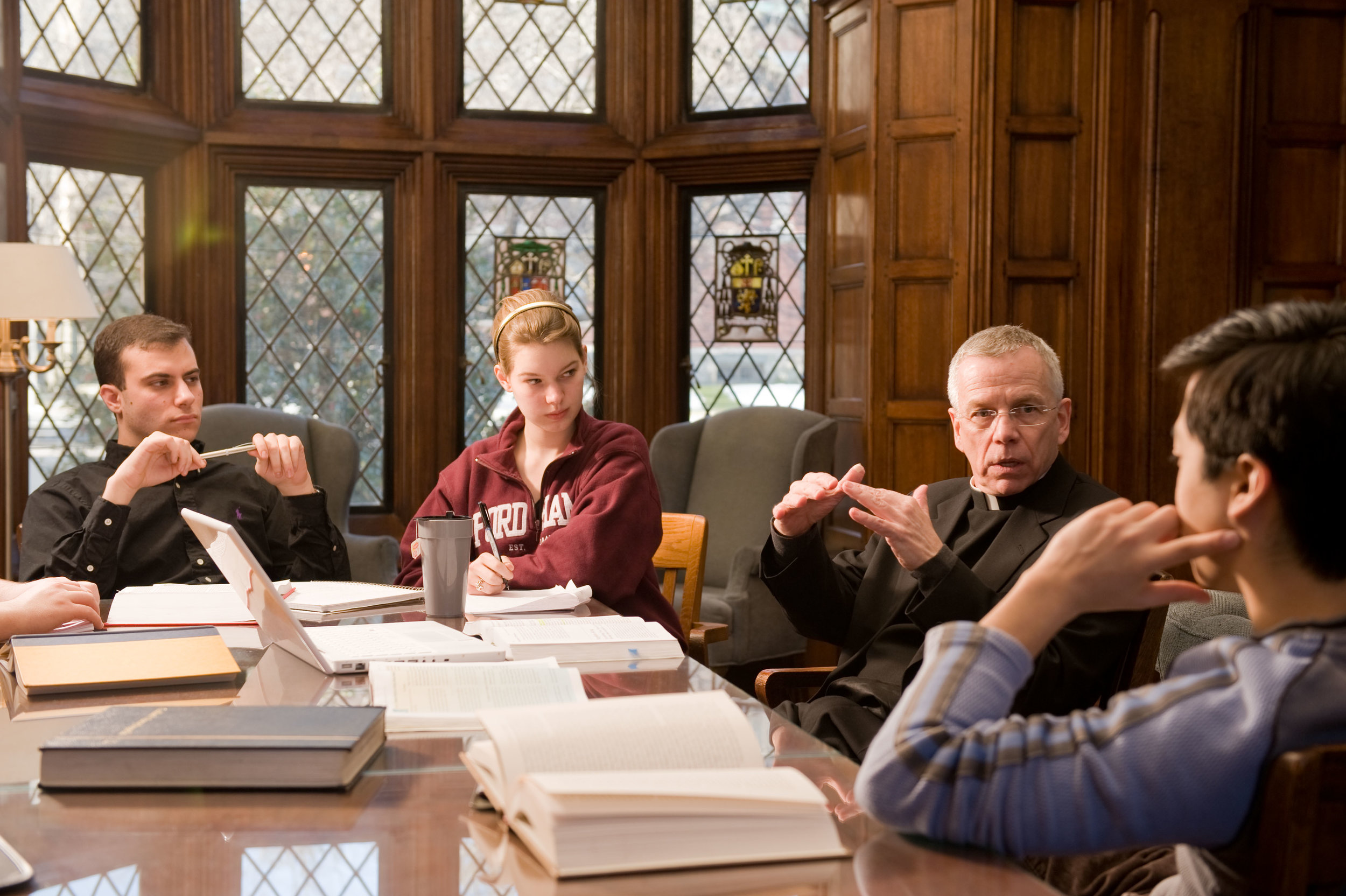 Students in a classroom discussion with  Fr. David Marcotte SJ  at  Fordham University .