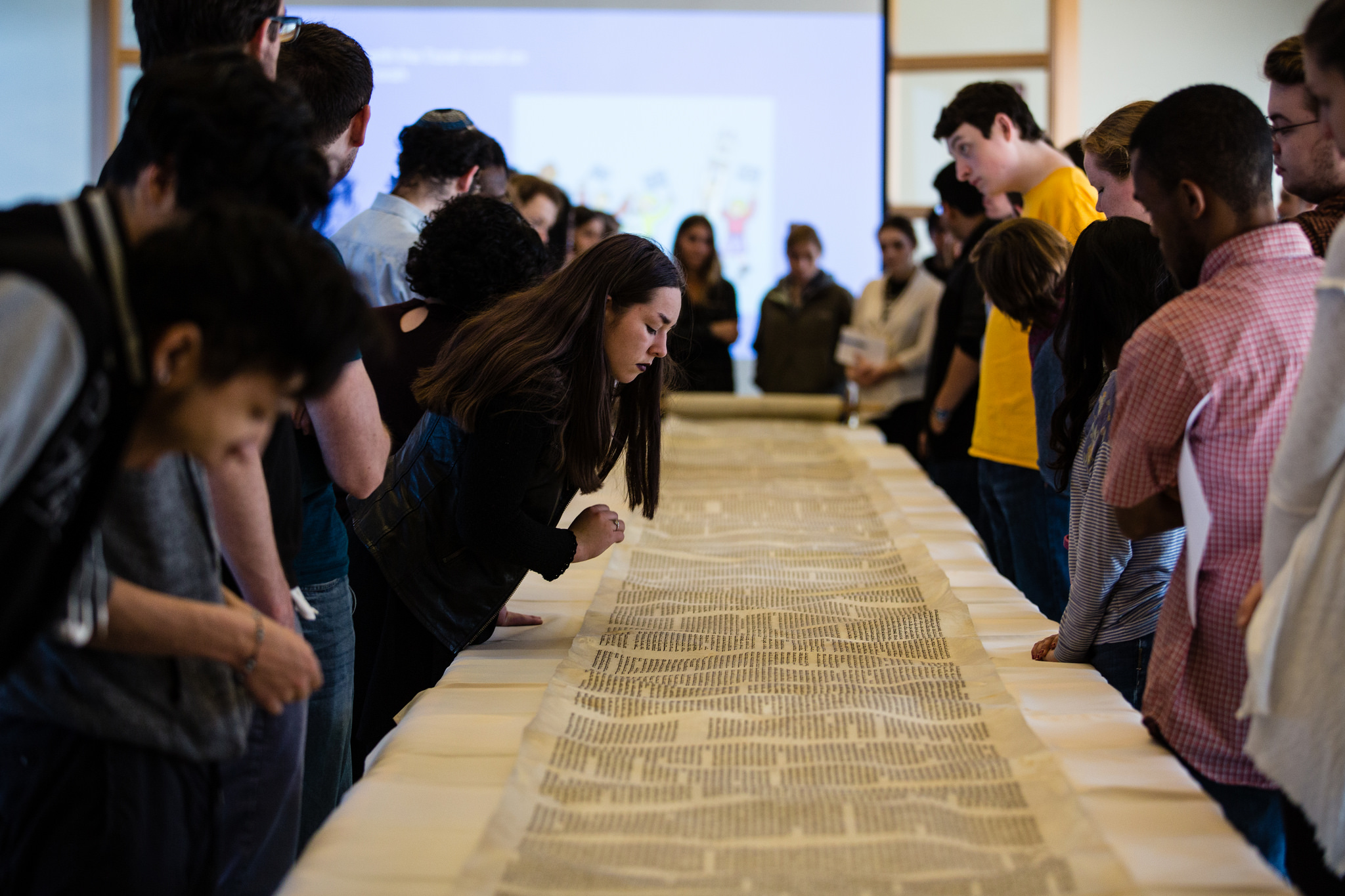 Students see a Torah scroll hundreds of years old at  Loyola University Chicago . Photo Courtesy of the University.