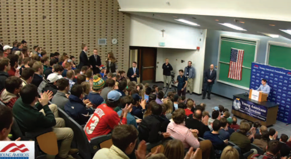 Ben Shapiro speaks to students in a packed lecture hall at  Marquette University .