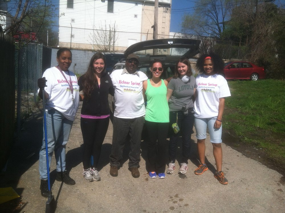""""""" Richnor Springs Residents and Loyola University Maryland Students Collaborate to Clean up a Community Adopted Lot""""is courtesy of Allen Brizee."""