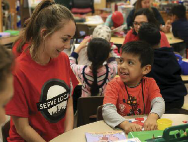 Seattle University students work with Bailey Gatzert Elementary School students during the After School program as part of the SUYI. Photos courtesy of Seattle University. Photographer: Yosef Kalinko
