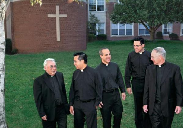 Jesuits Joseph Papaj, Lito Salazar, Rocco Danzi, Brent Otto, and Vincent Sullivan enjoying their vocation on the grounds of Saint Peter's University.