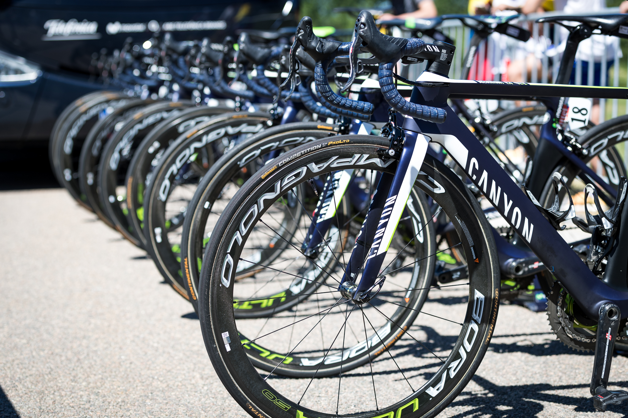 "Movistar joins the pantheon of ""neatly arranged bicycles"" pictures! Canyon Aeroad frames, with Campagnolo groupset and wheels. Super hot. ALSO, CANYON BIKES, WHEN WILL YOU START DISTRIBUTING IN THE US?! HURRY UP AND SHUT UP AND TAKE MY MONEY!"
