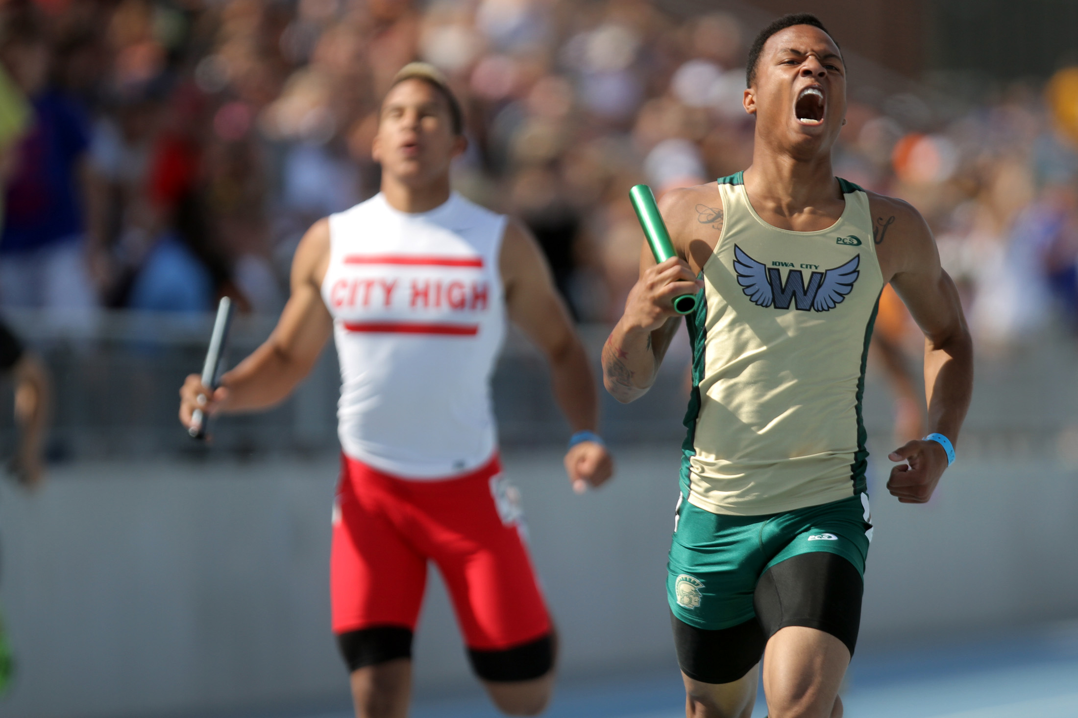 West High's Armando Williams celebrates his team's victory in the 4x200-meter relay race at the Iowa State Track Meet at Drake Stadium.