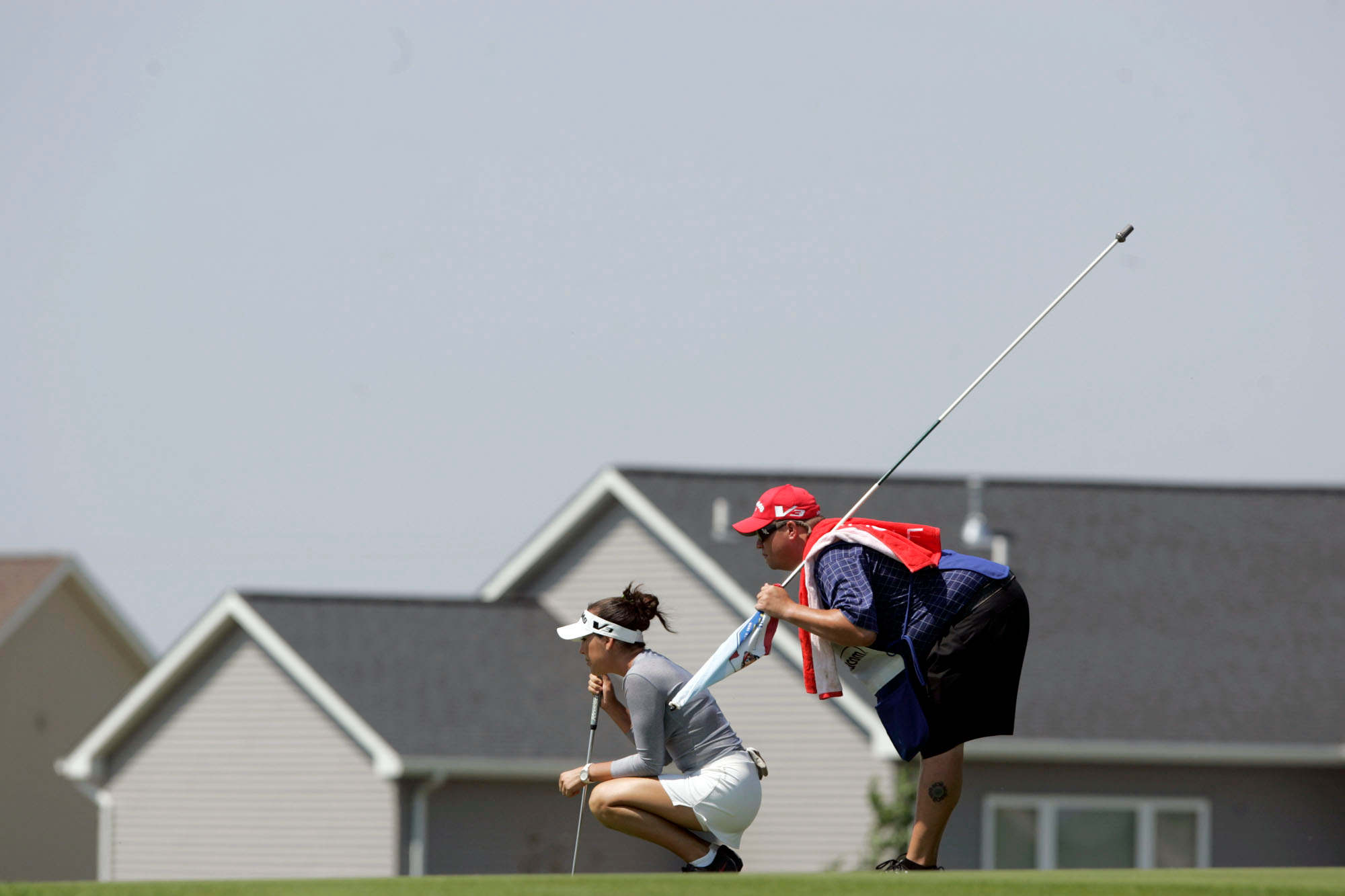 Carling Coffing and her caddy line up her putt on the seventh hole green during the final round of the Ladies Titan Tire Challenge at Hunters Ridge Golf Course in Marion.