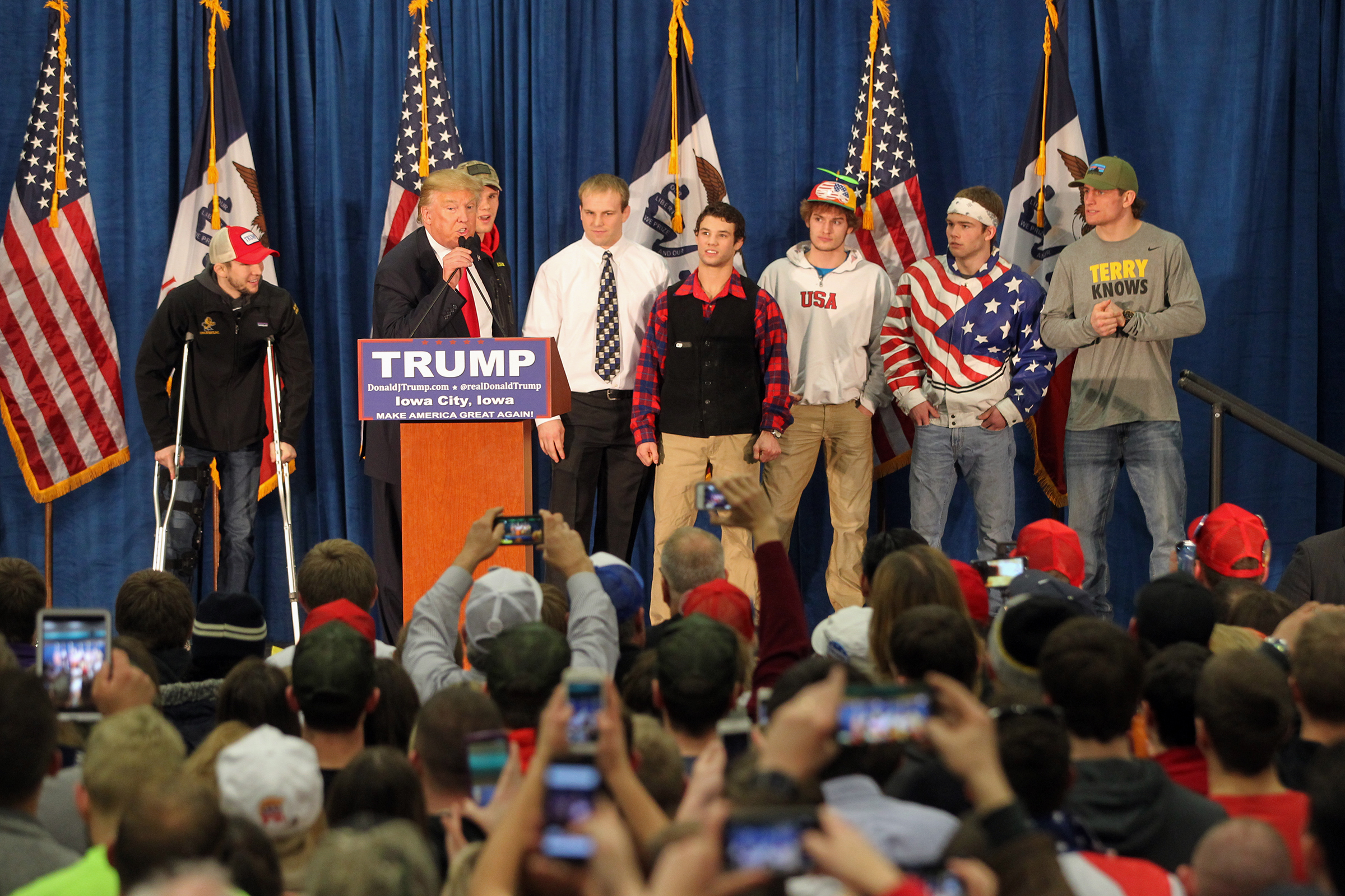 Republican presidential candidate Donald Trump greets members of Iowa's wrestling team at the UI Field House.