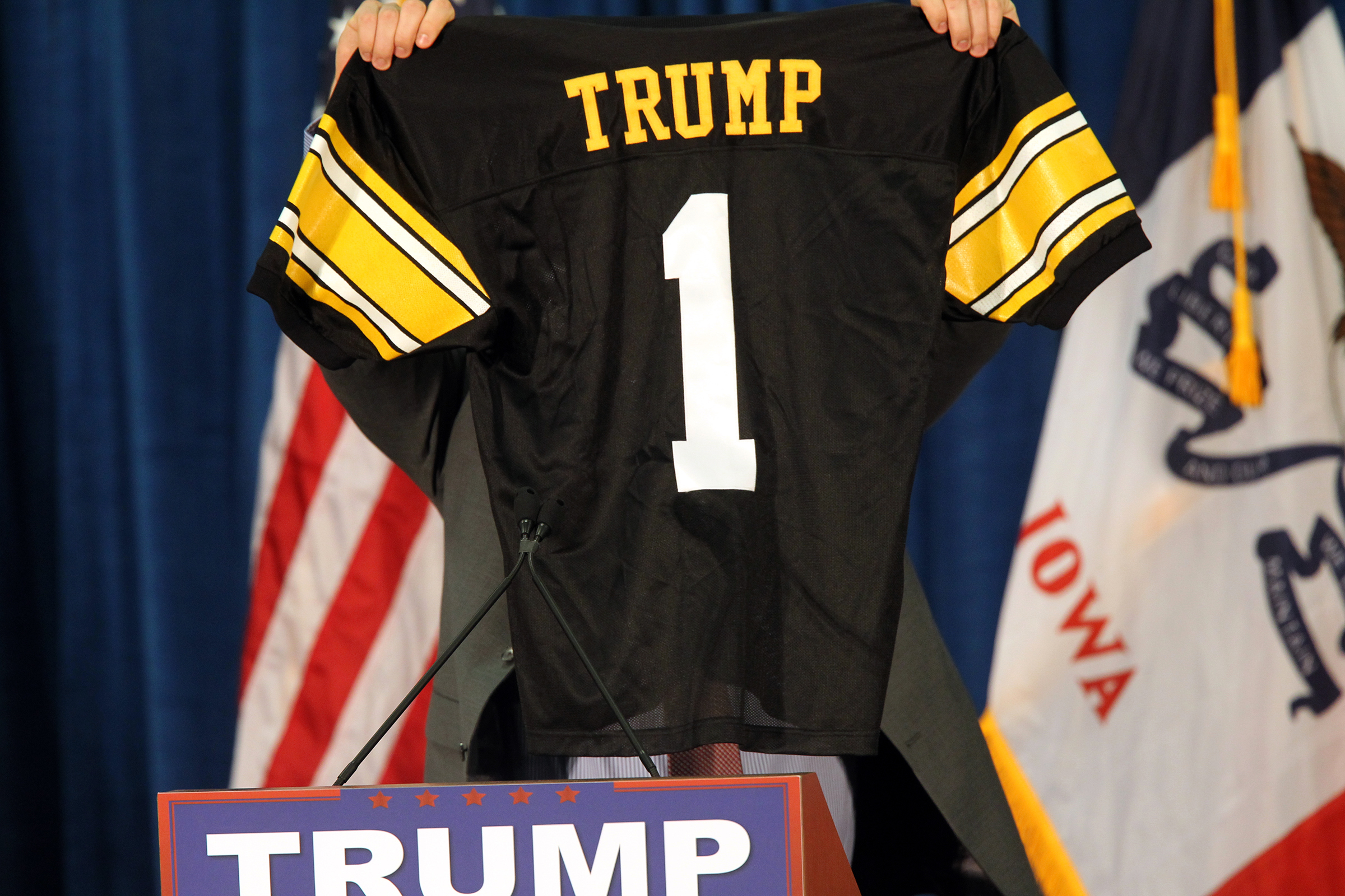 Iowa tight end Peter Pekar displays a personalized jersey for Republican presidential candidate Donald Trump at the UI Field House.