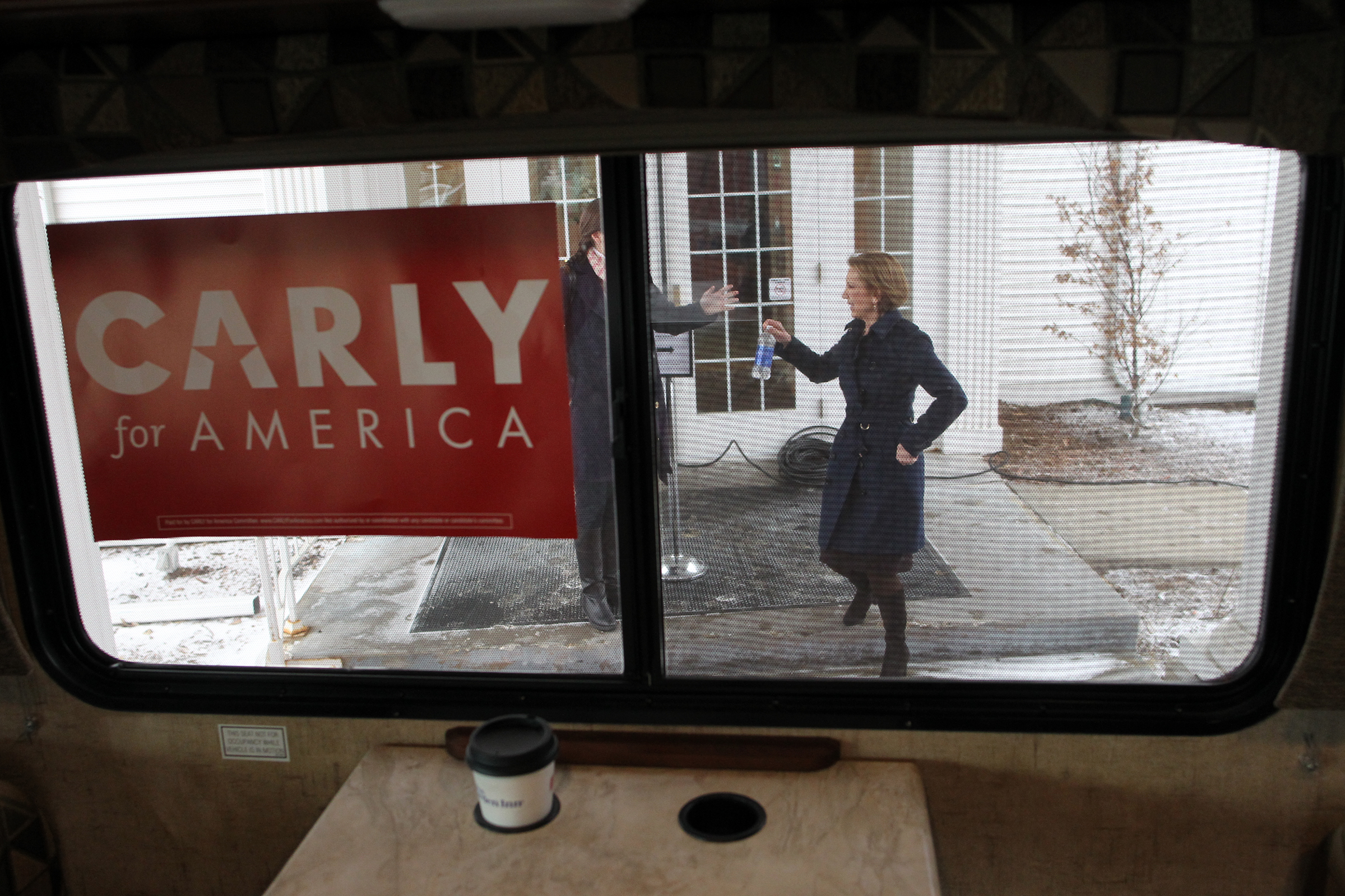 Republican presidential candidate Carly Fiorina heads to her campaign bus following a town hall meeting in Iowa City.