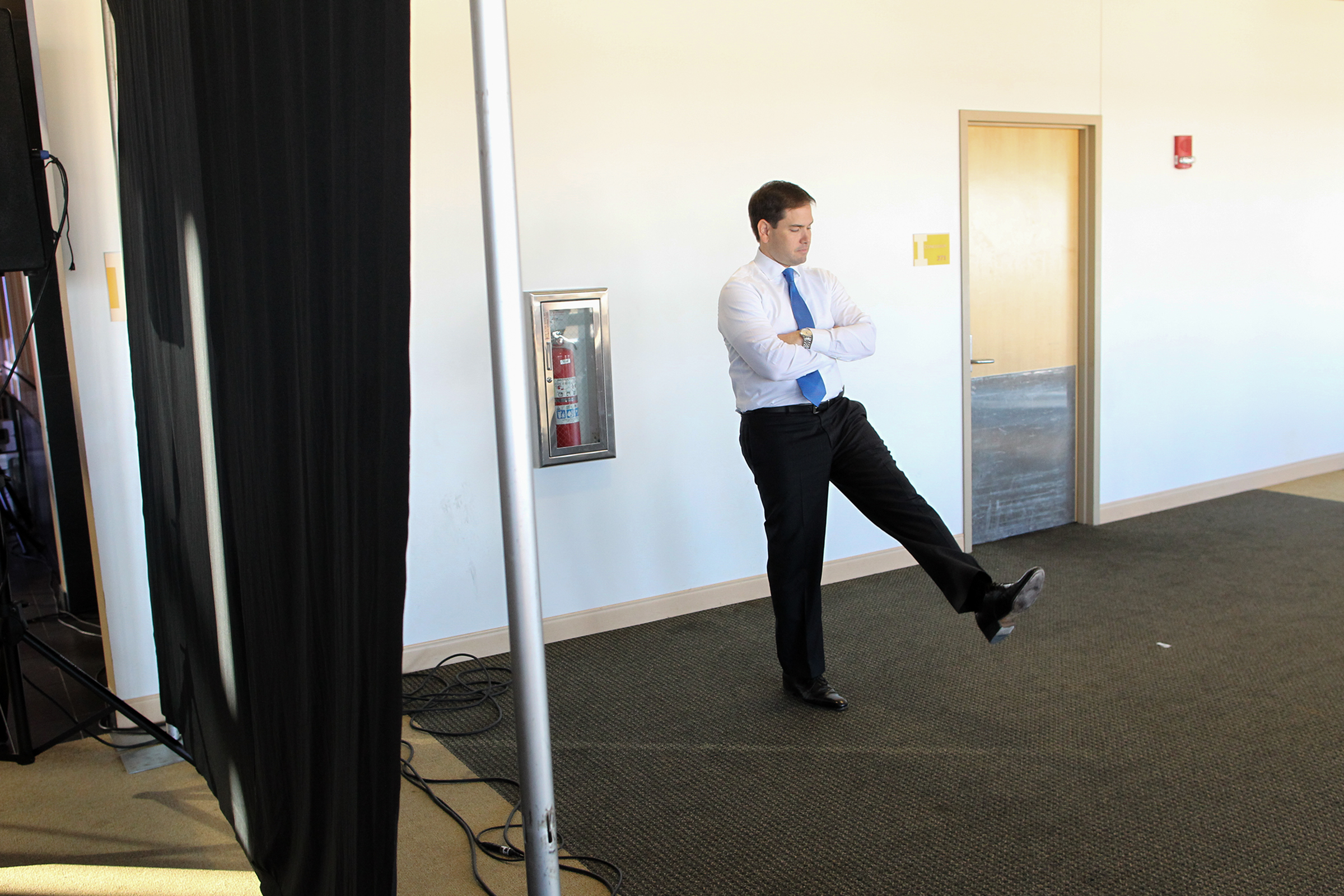 Republican presidential candidate Marco Rubio waits to be introduced to guests at Kinnick Stadium.