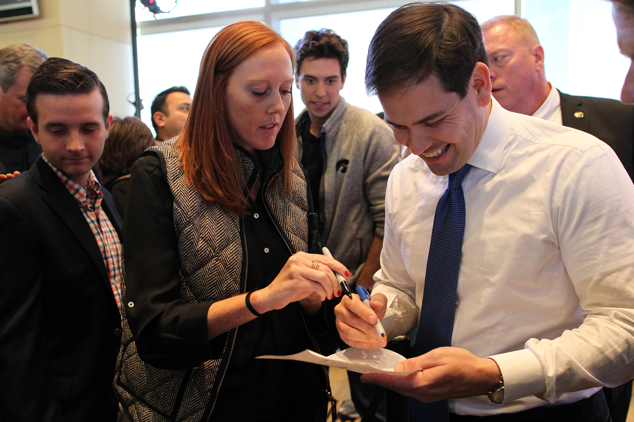 UI graduate student Josie Rudolphi asks Republican presidential candidate Marco Rubio to sign a permission slip to get her out of class following his speech at Kinnick Stadium.