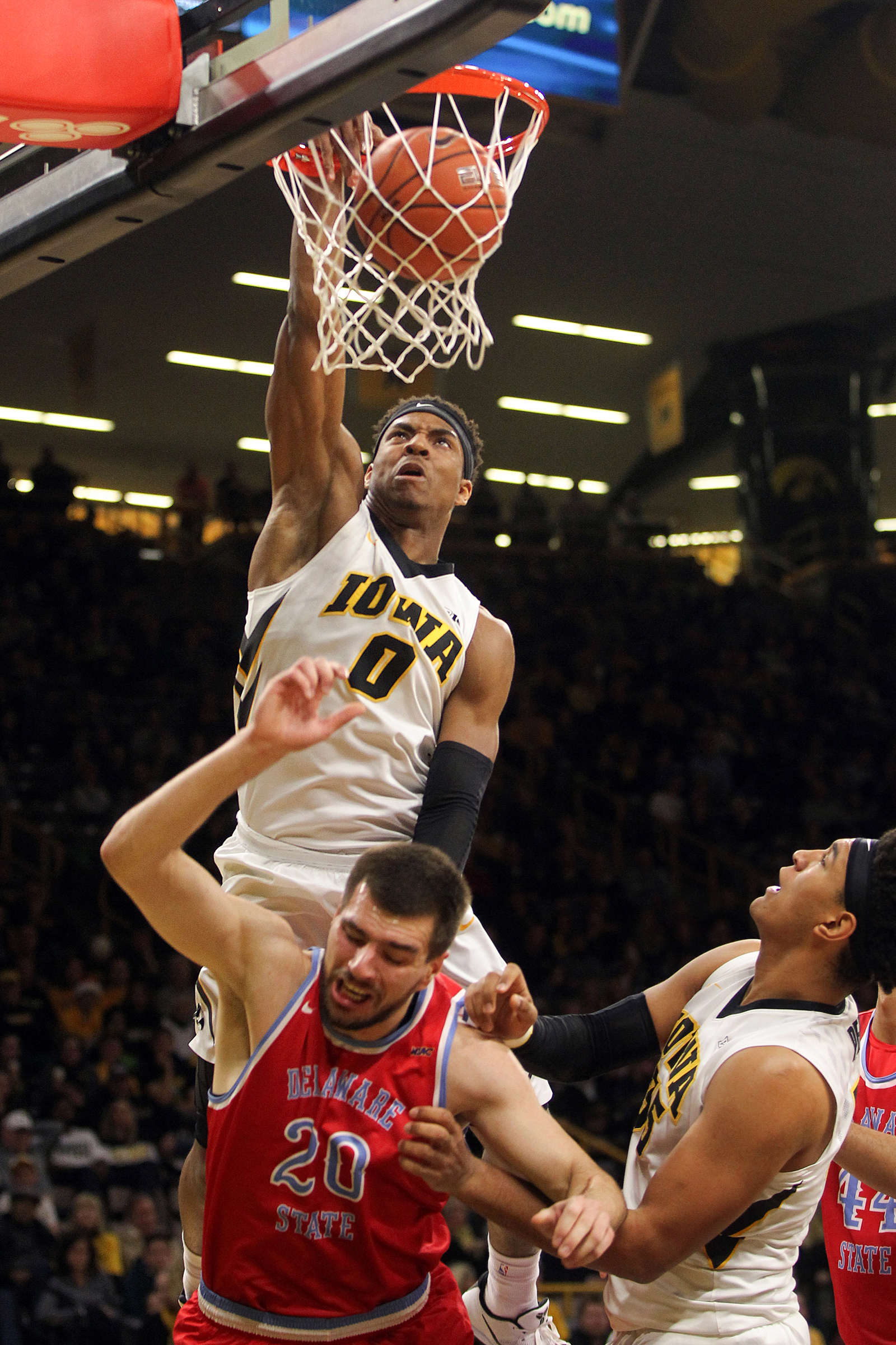 Iowa's Ahmad Wagner dunks the ball, but gets called for a foul, during the Hawkeyes' game against Delaware State at Carver-Hawkeye Arena.