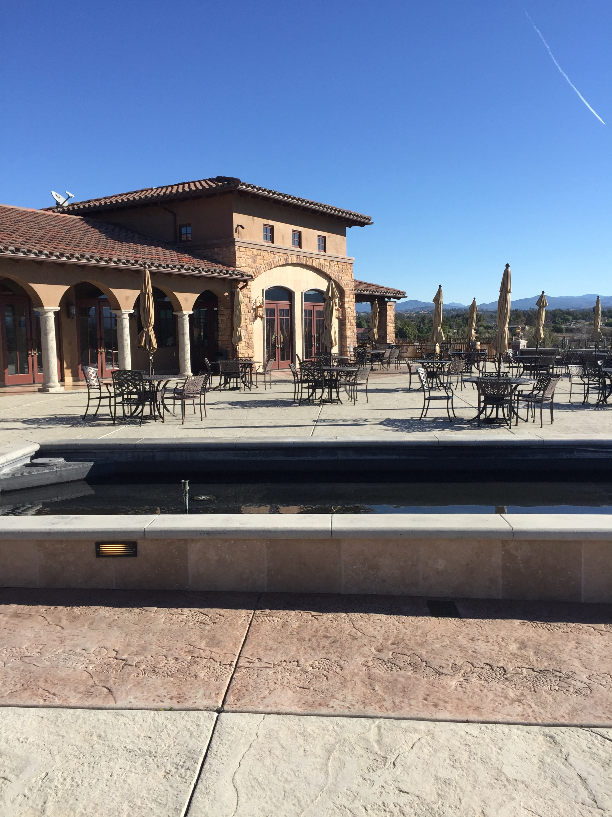 Grab a glass and take in the view of Temecula Wine Country at Monte De Oro.