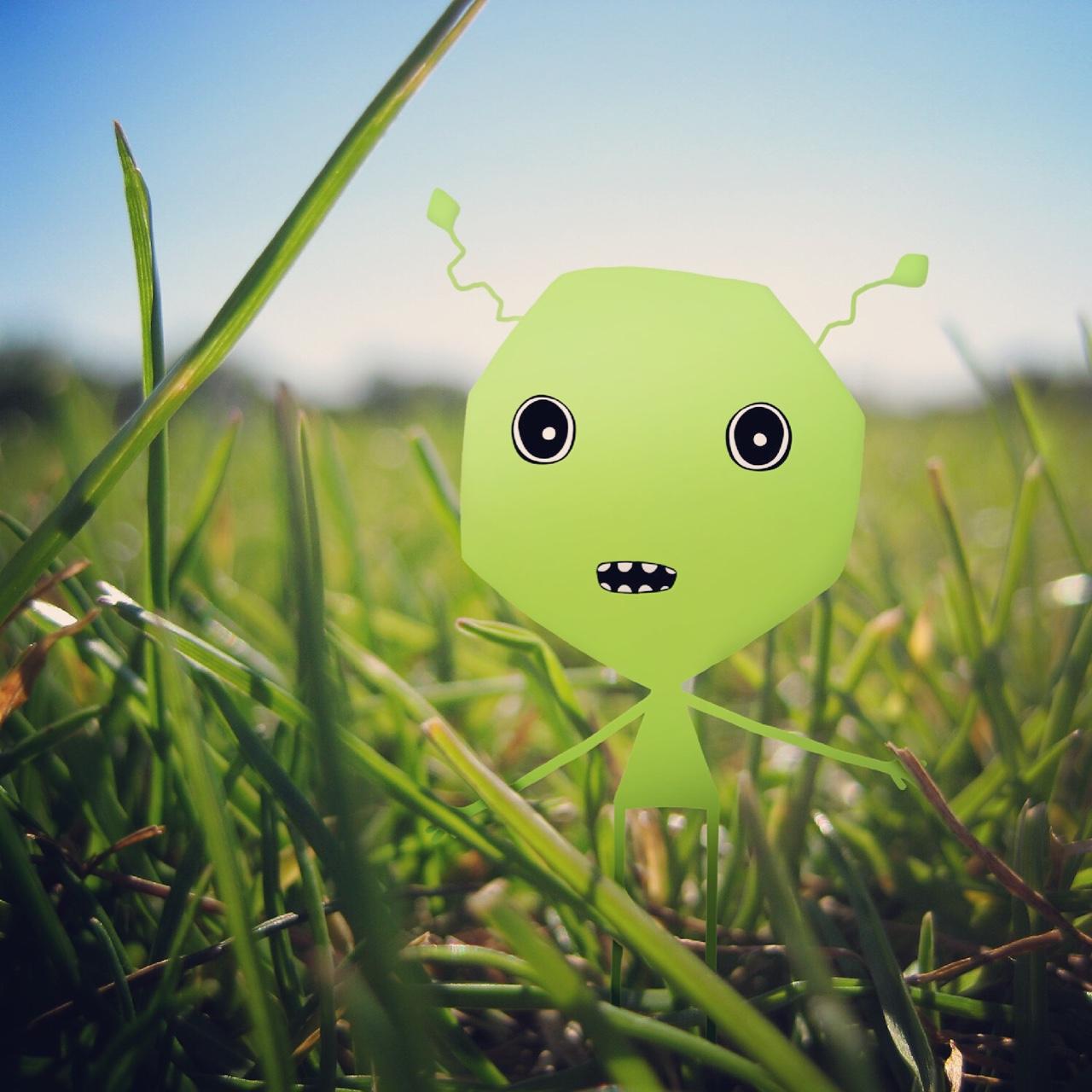 A tiny Handymartian hiding in the grass.