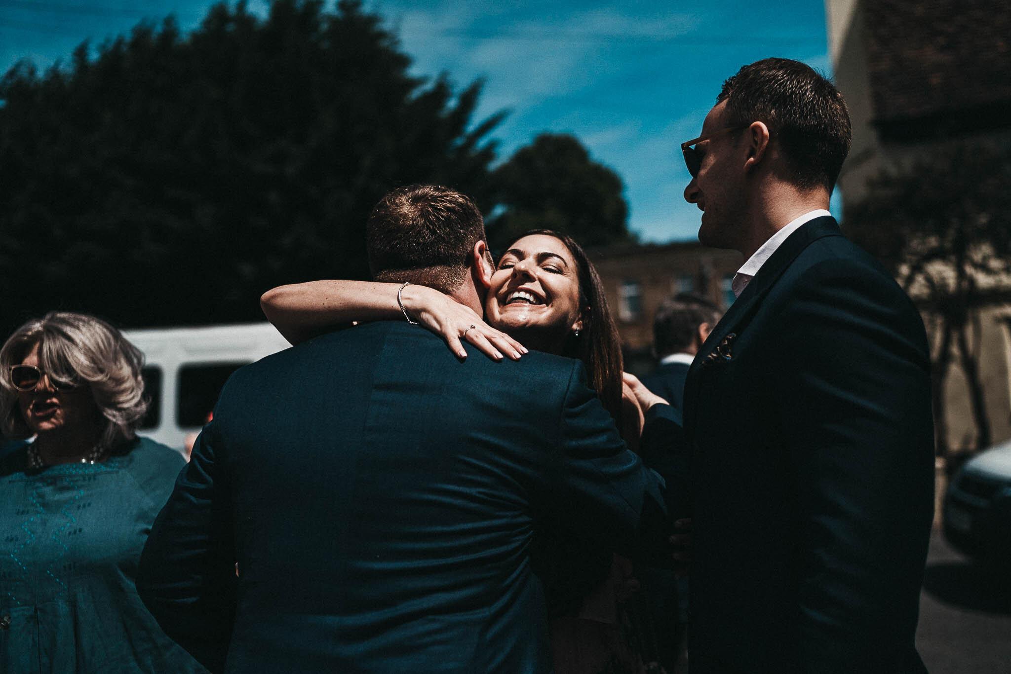 groom-greeting-guests