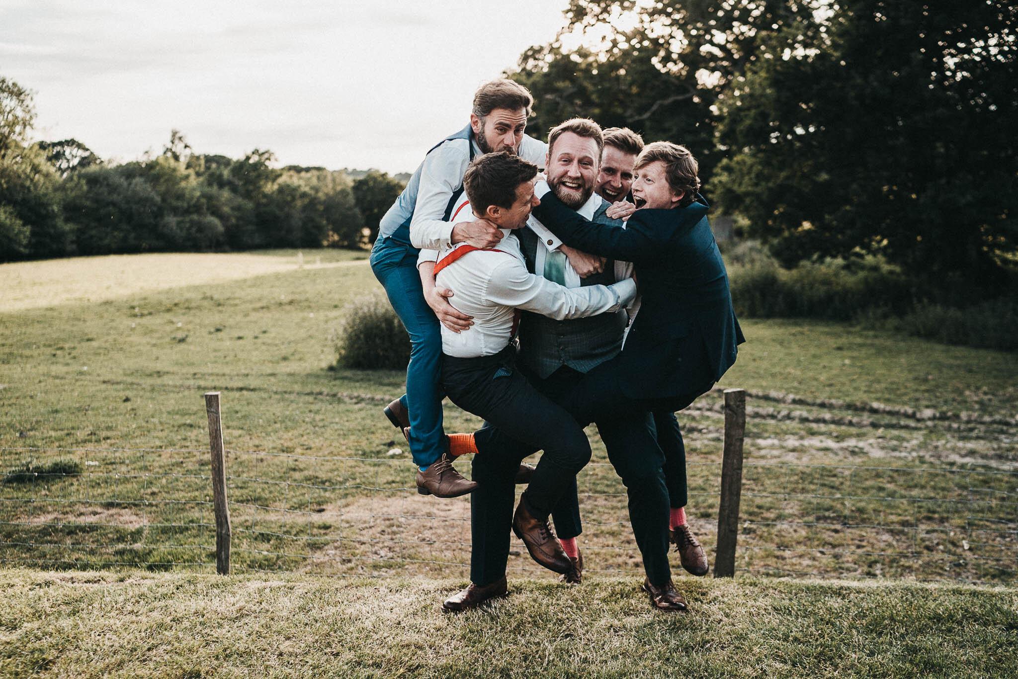 groom-carrying-groomsmen