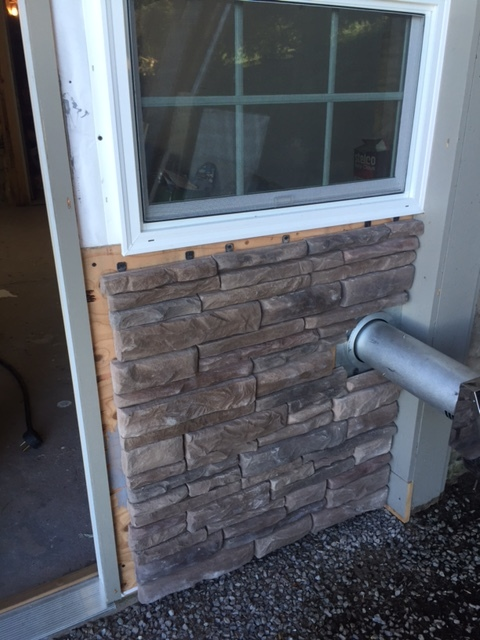 The new stone facade. The only thing left it trim!