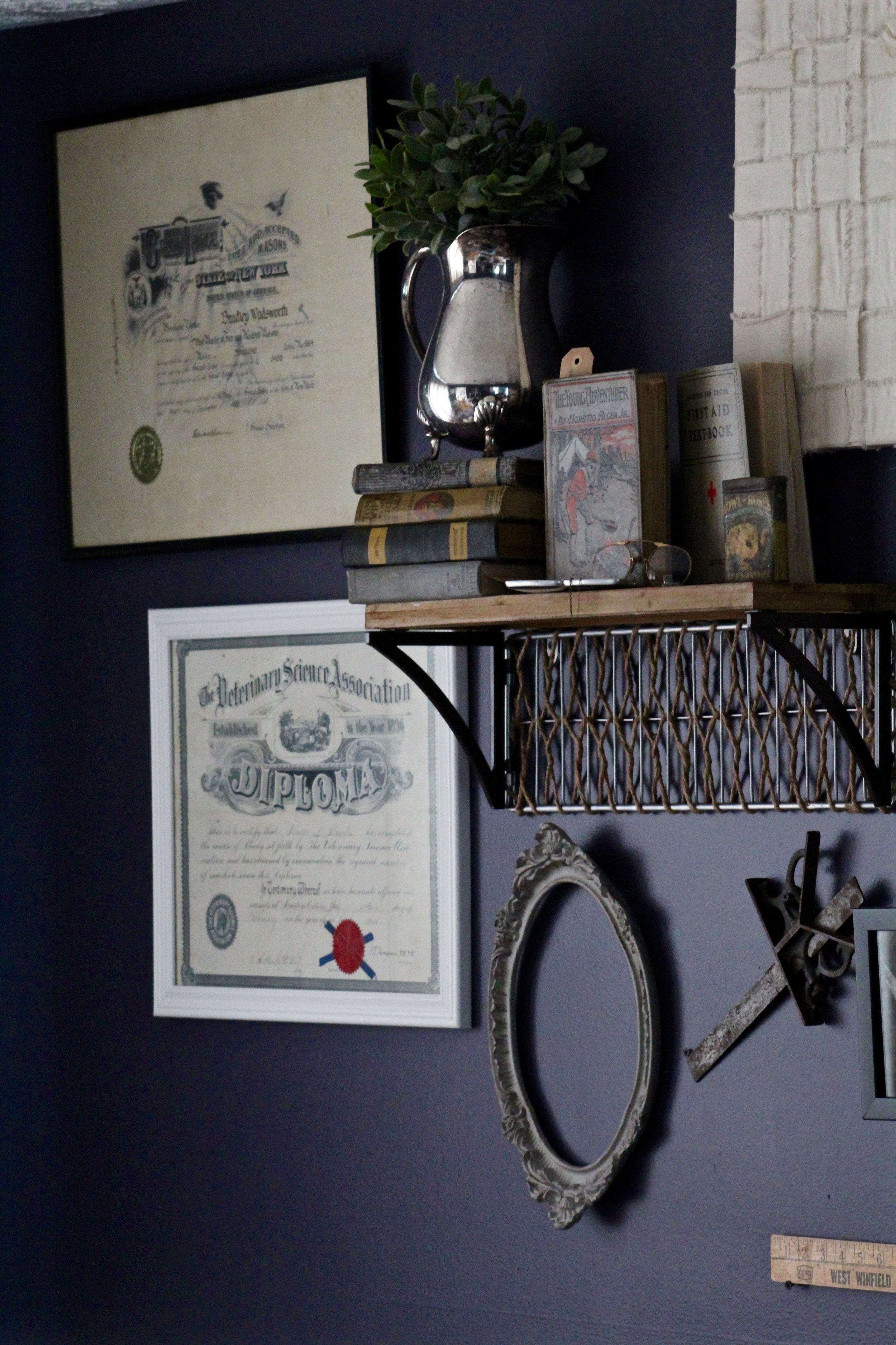 This wall is filled with items we've collected from our family's past. Such as a Veterinary Diploma from my Great Grandfather, a morse code tapper from Steve's Great Grandpa, Tools from family stone masons, and My Grandma and Grandpa's wedding announcement and coverage from the local paper.