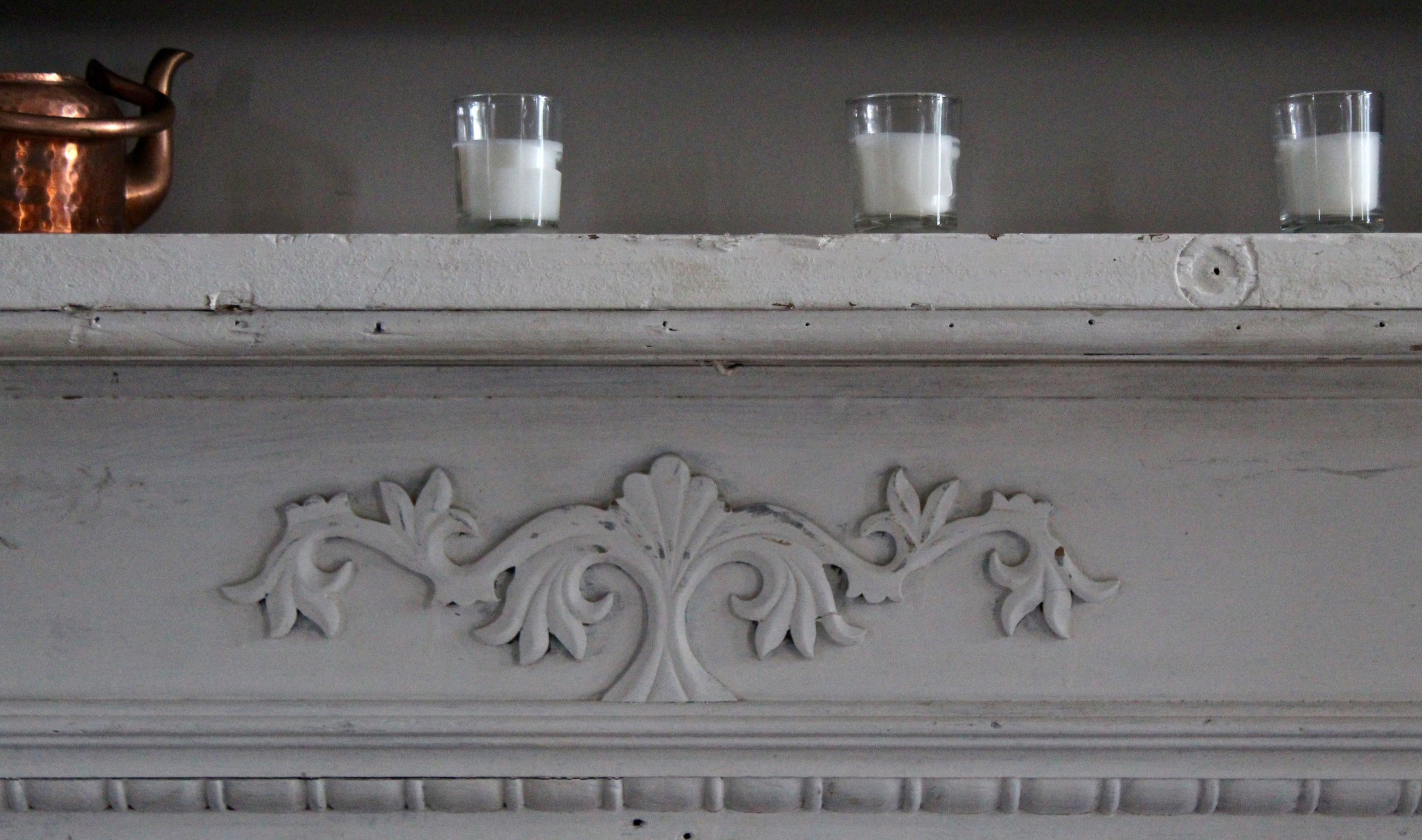 We found this mantel at an amazing local architectural salvage store. We gave the owner the dimensions of our fireplace insert and he took us around the whole store. Two buildings and nothing fit. Then he remembered this was in the back of his pick up and it fit PERFECTLY. I think it was fate because he  hadn't even pulled it out of his truck to  he clean it up for sale yet.  We didn't paint or refinish it. Every scrape tells the story of it's journey to our home. We LOVE that about it.