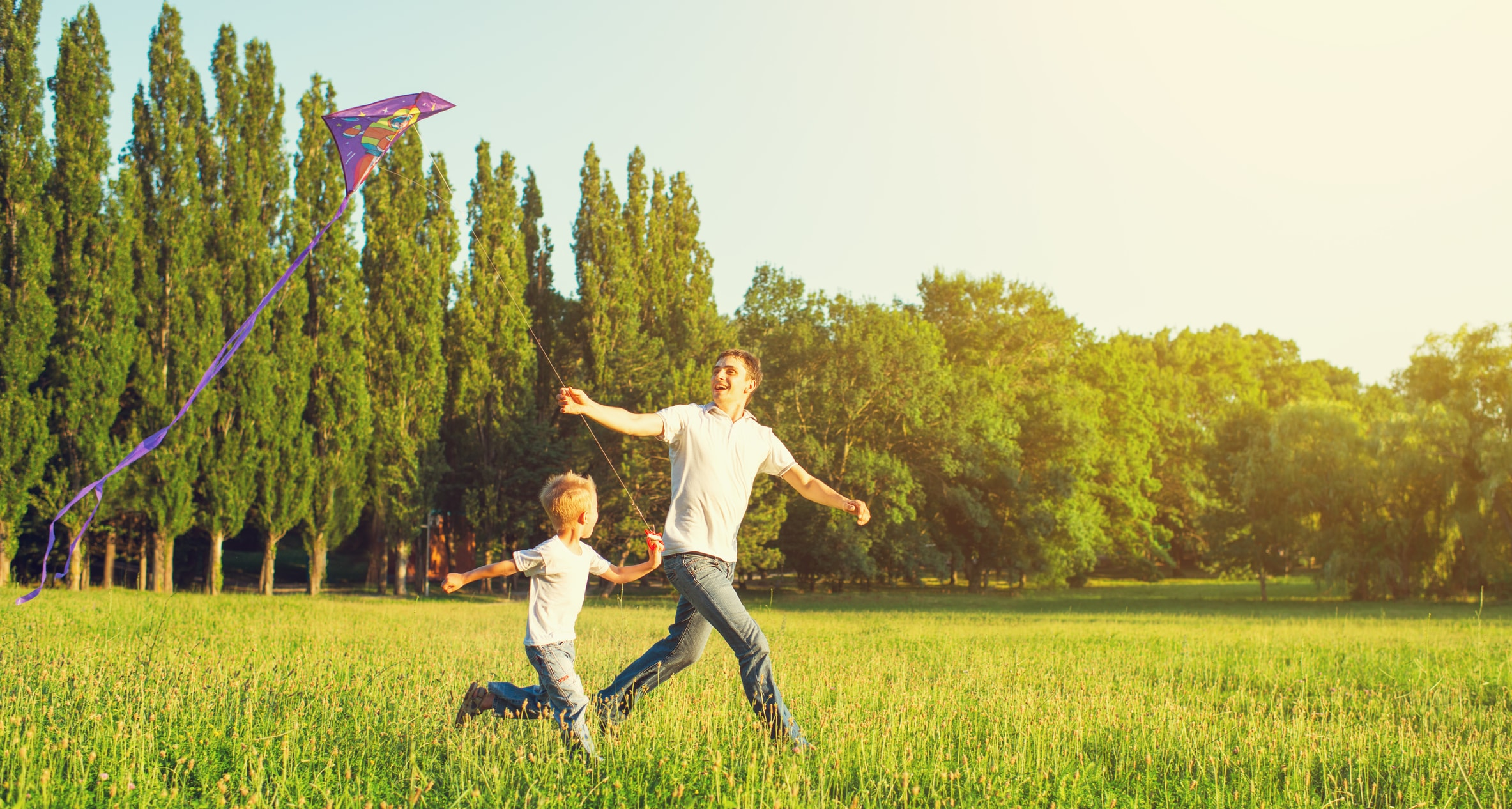 dad-and-son-child-flying-a-kite-in-summer-nature-43238819-min.jpg