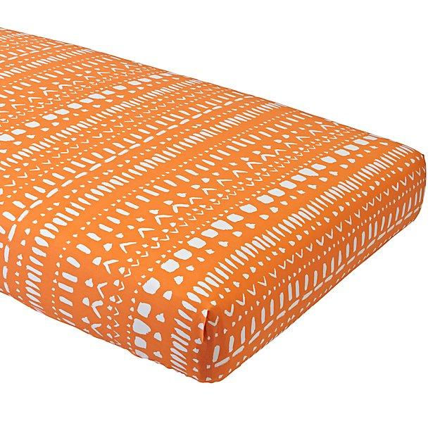 orange-tribal-fitted-crib-sheet.jpg