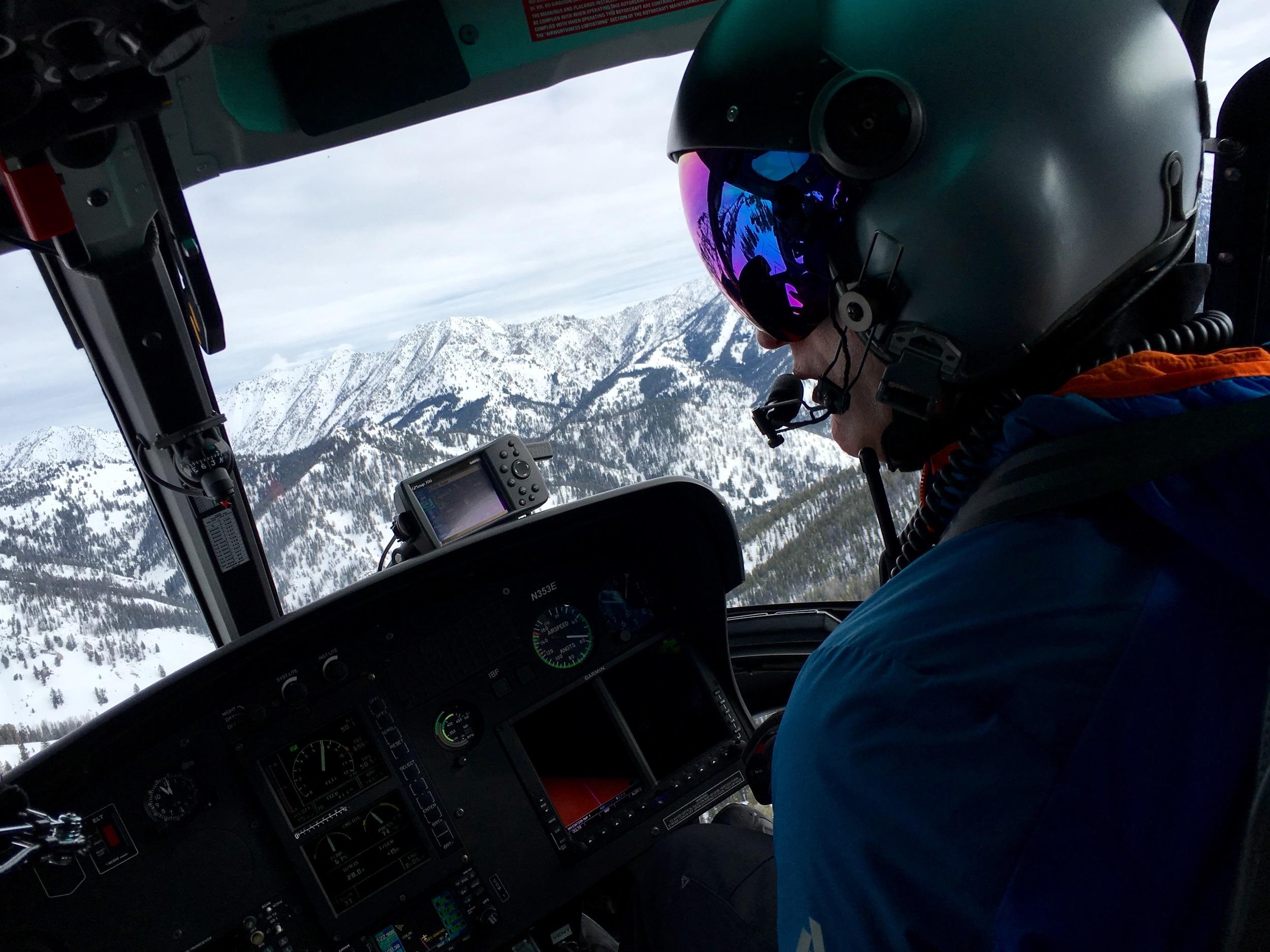SVHS pilot Chris Templeton spots a landing zone atop an Idaho peak.