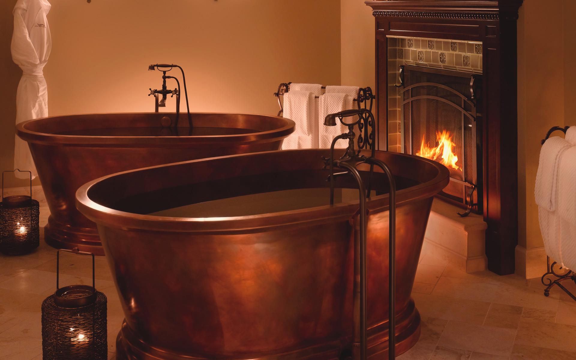 Mr. Luxury Ski prefers to have his apres-ski soak by a crackling fire.