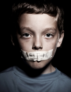 stock-photo-teen-with-taped-mouth-begging-for-help-sad-abuse-boy-violence-despair-119486863.jpg