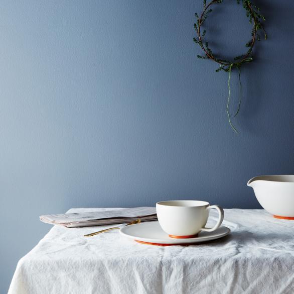 White and copper ceramic mug