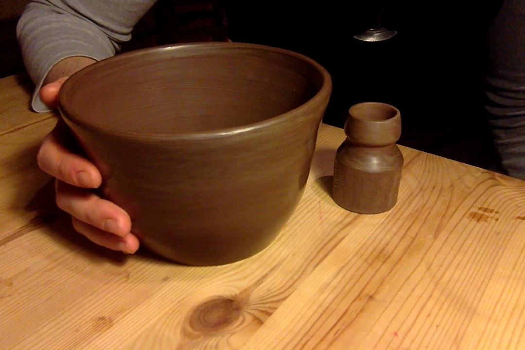Pre baked pots, doing some throwing practice.