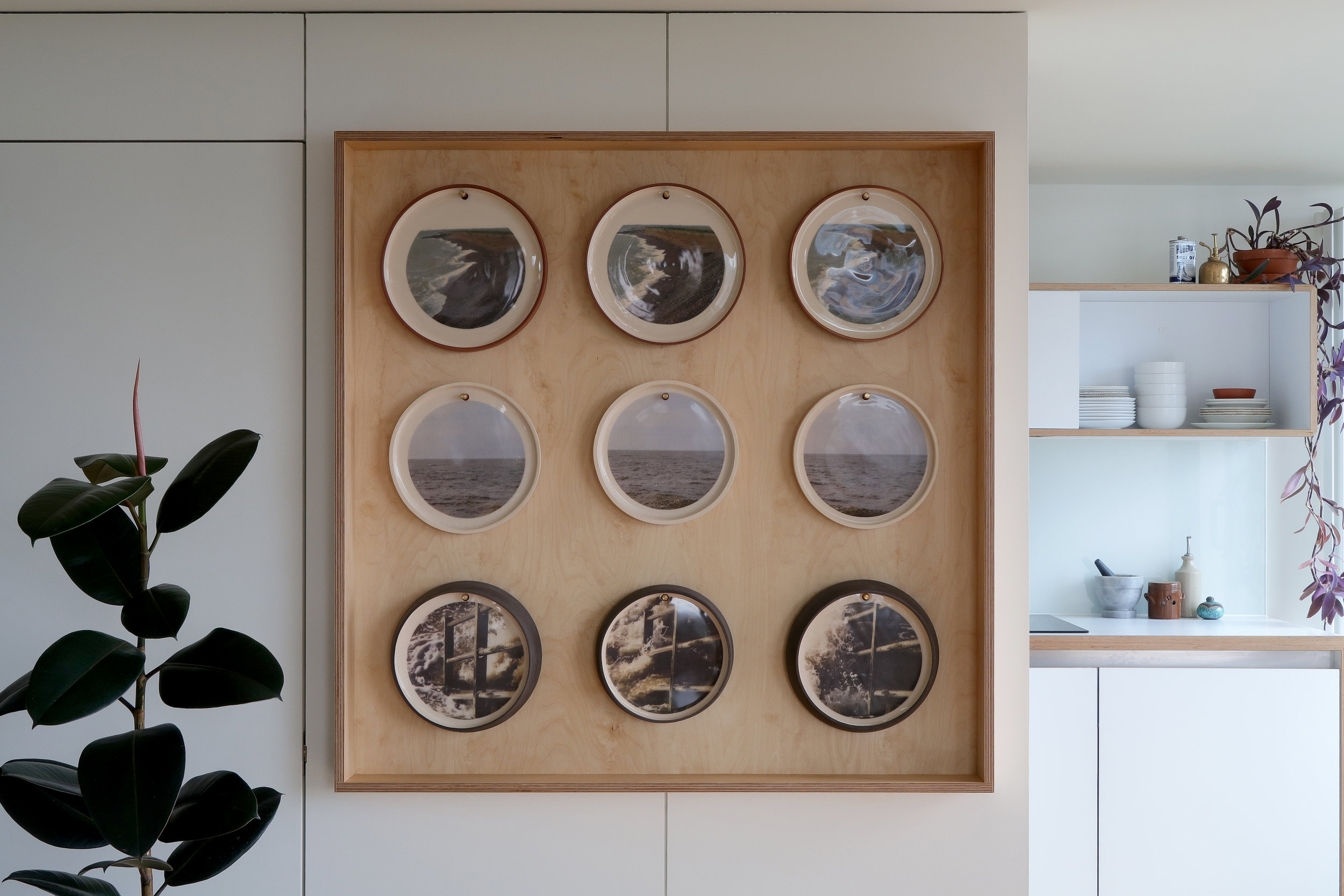 A three second series. Thrown and burnished terracotta, stoneware and black clays, decorated with slip, glaze and digital film stills. Custom display case in waxed birch with brass and leather detail pegs.