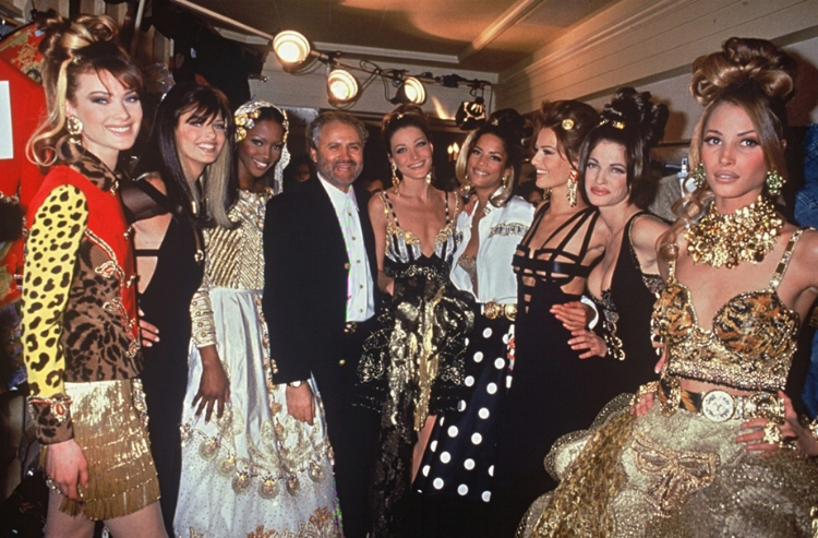 Gianni Versace with Shalom Harlow, Linda Evangelista, Noami Campbell, Carla Bruni, Veronica Webb, Karen Mulder, Stephanie Seymour & Christy Turlington at a backstage of his fashion show