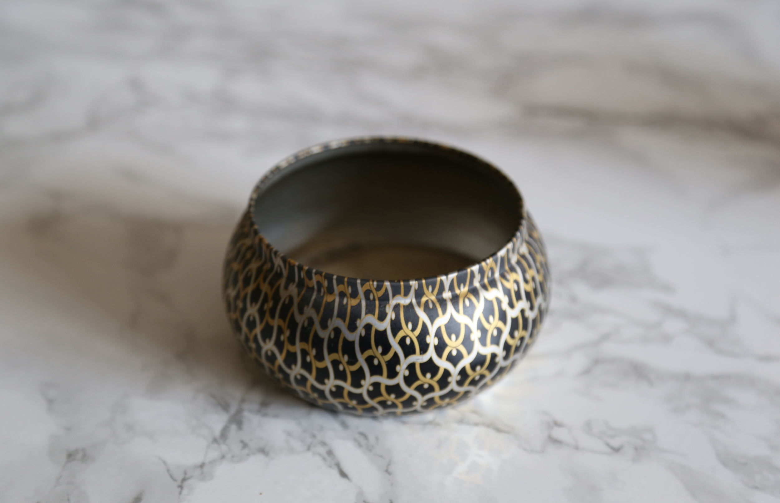Start with an empty candle. I love  Voluspa  because they have such beautiful designs!