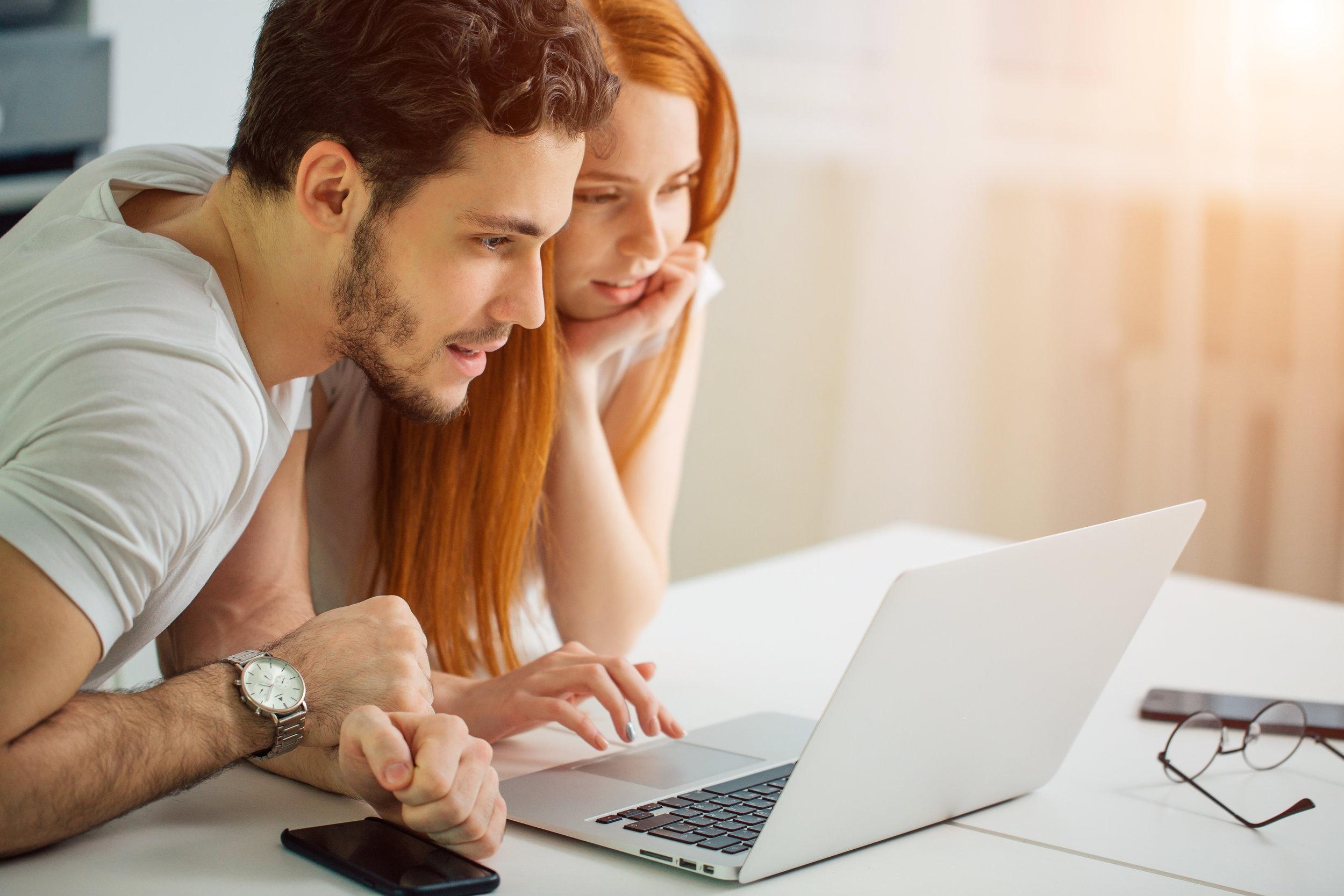 Couple looks at computer.jpeg