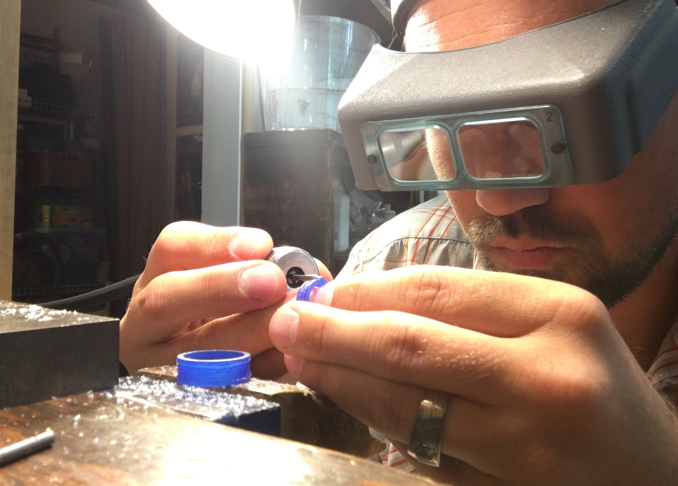 This process is done very carefully with a dremel type tool and old dental tools...