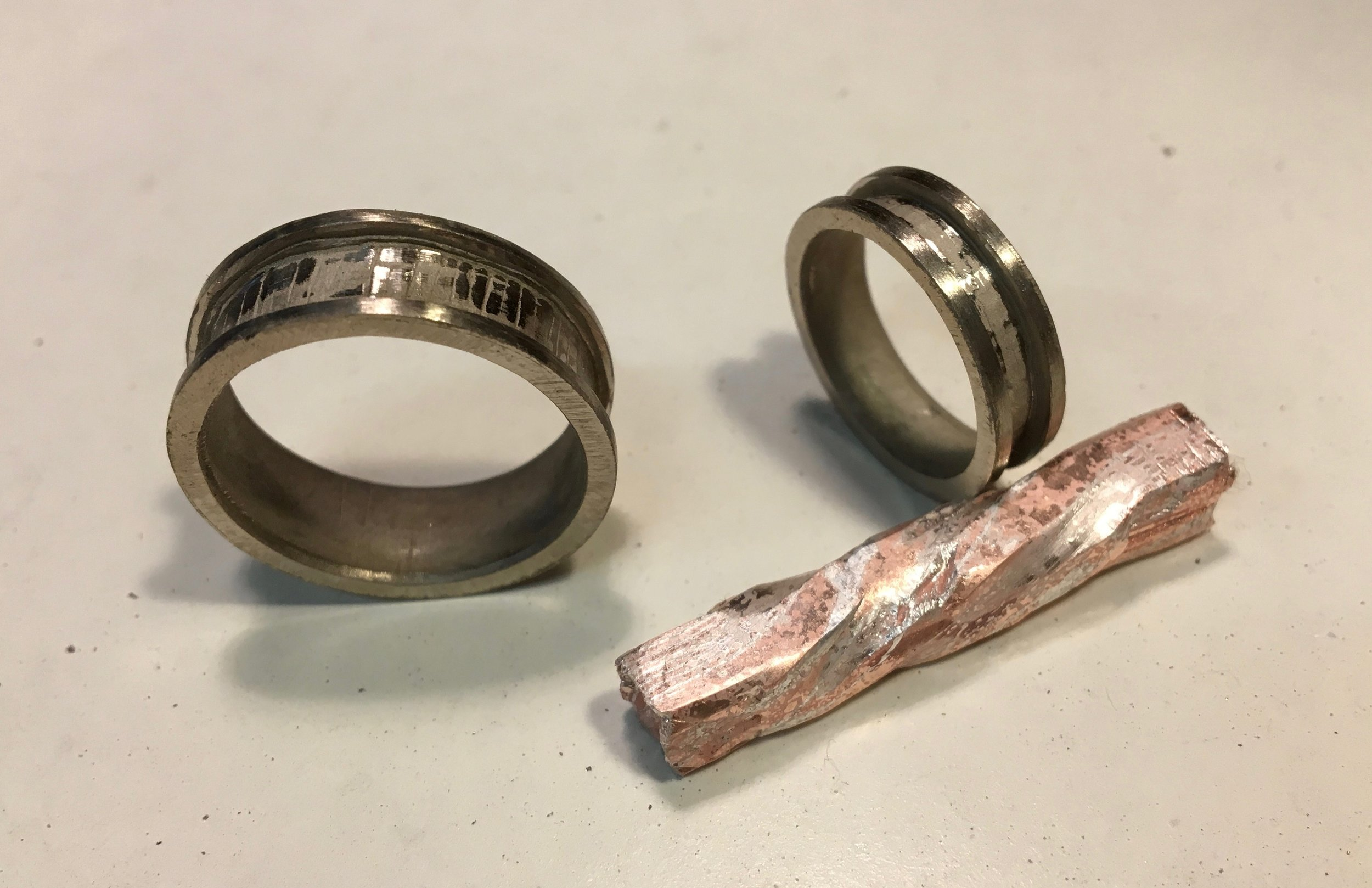 Here you can see the pattern starting to develop in the Mokume billet. The 14k white gold rings have been filed and are awaiting the mokume inlay...