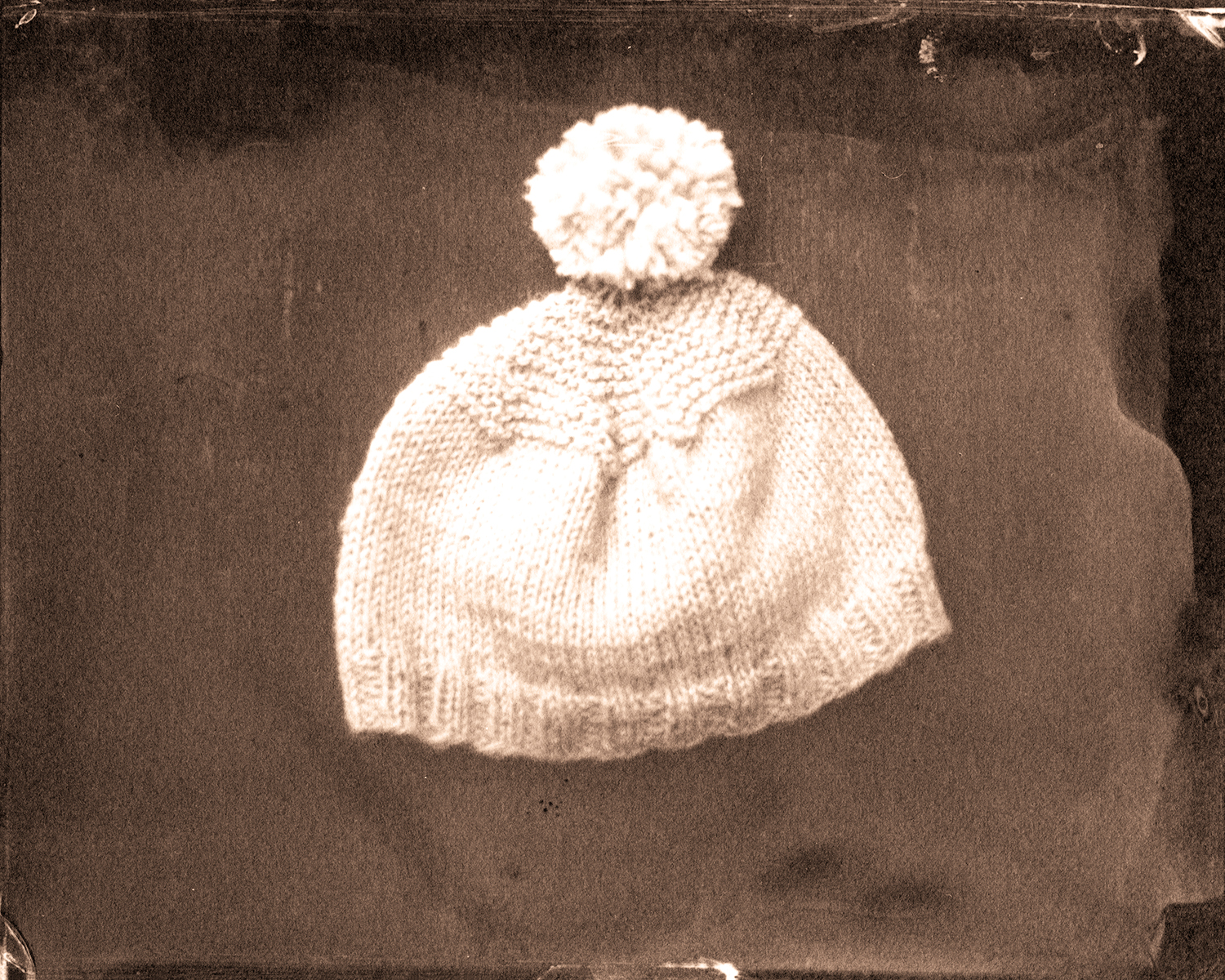 The birth cap she knitted for him.