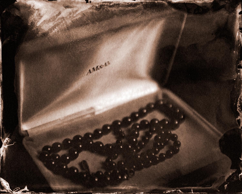Her favorite black pearls.