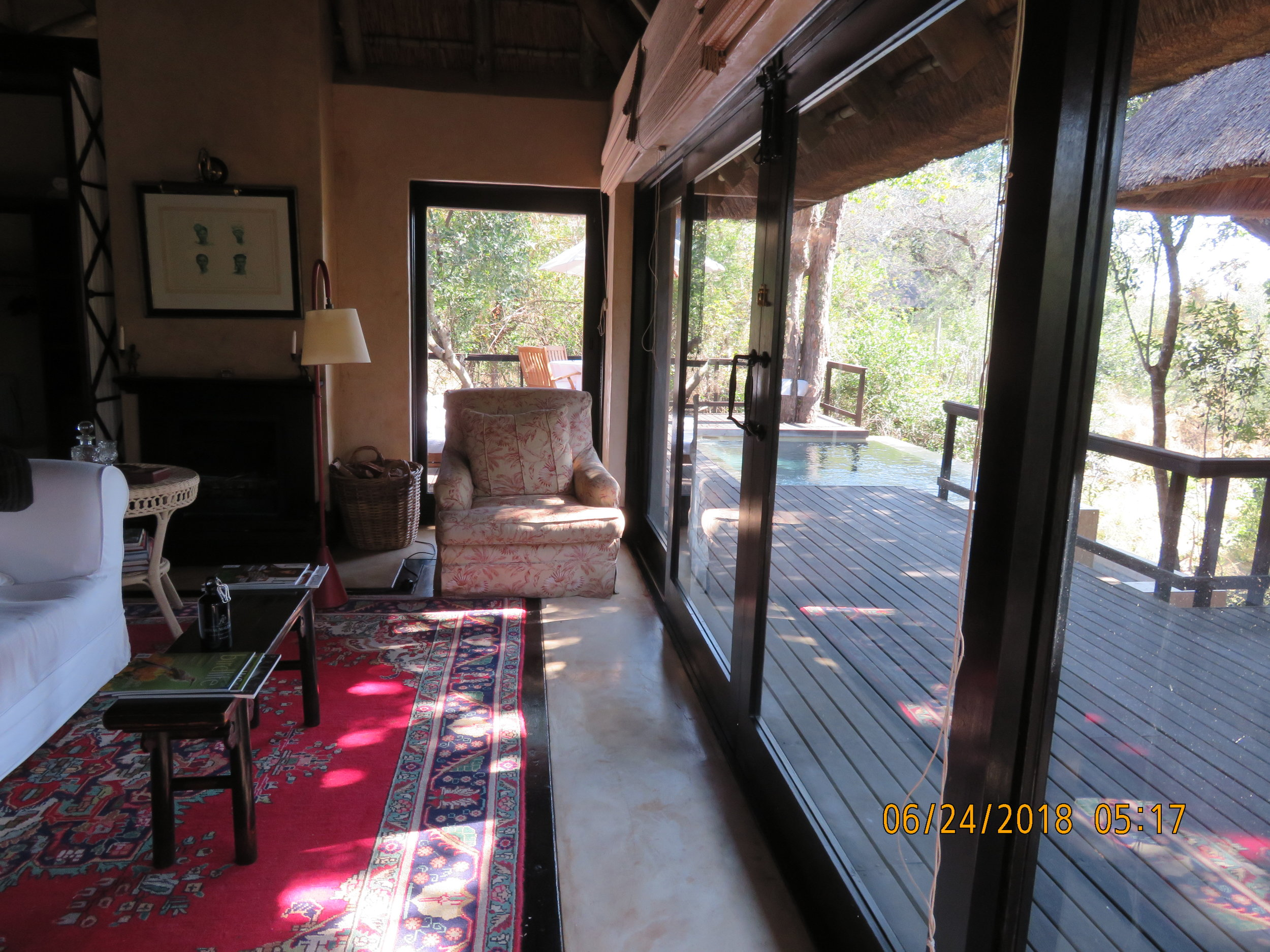Sitting Room and Deck and pool .JPG