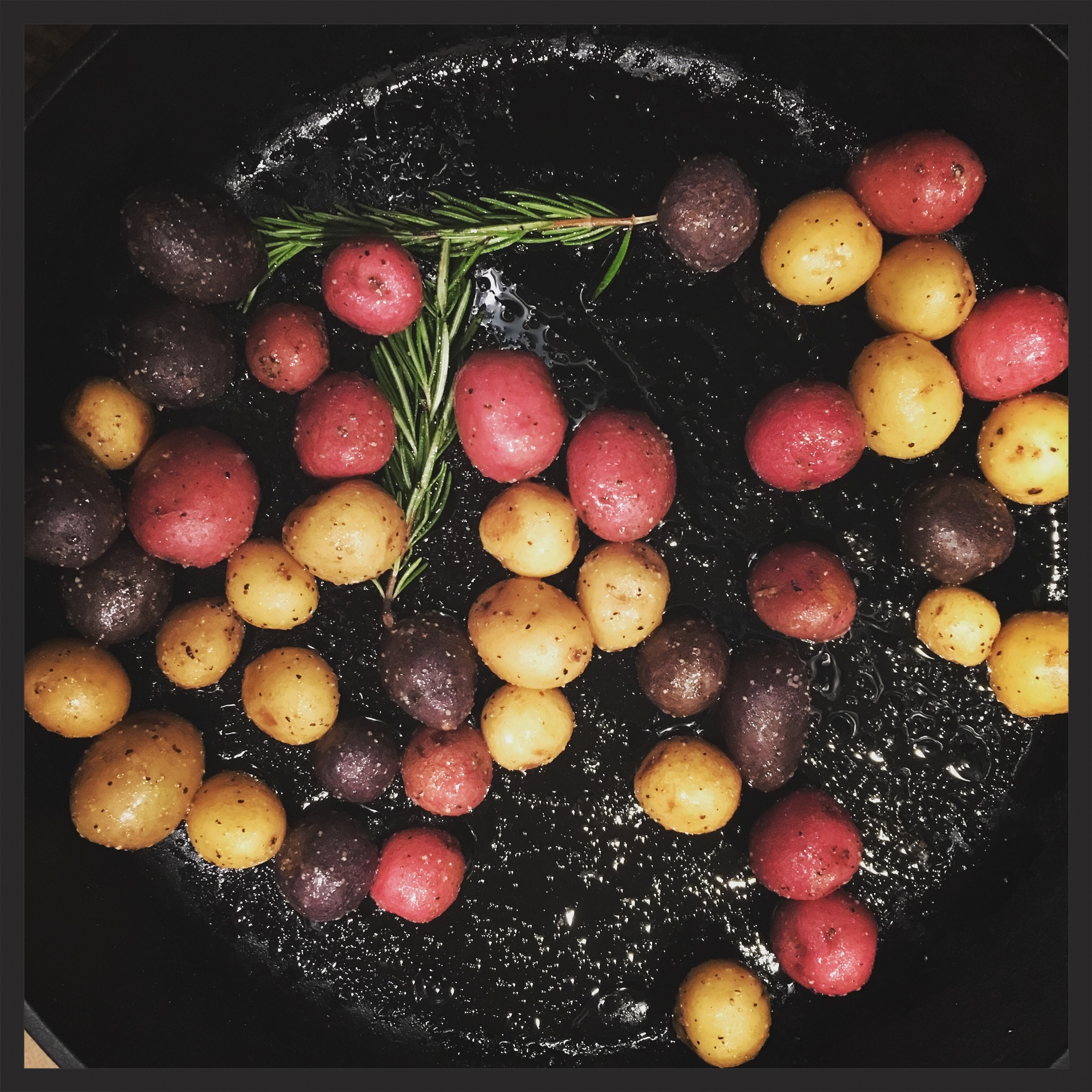 Oven-roasted white potatoes with rosemary and seasonings.