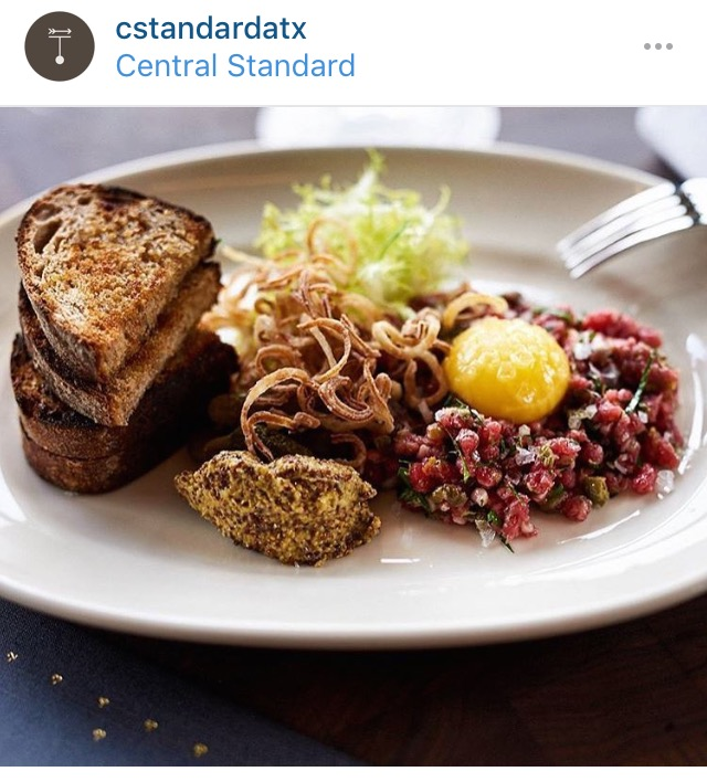"""Wagyu Tartar, with egg yolk, capers, grain mustard, and French pickles.  Since my photos were a little dark from the minimal lighting, I """"borrowed"""" some from Central Standard's Instagram."""