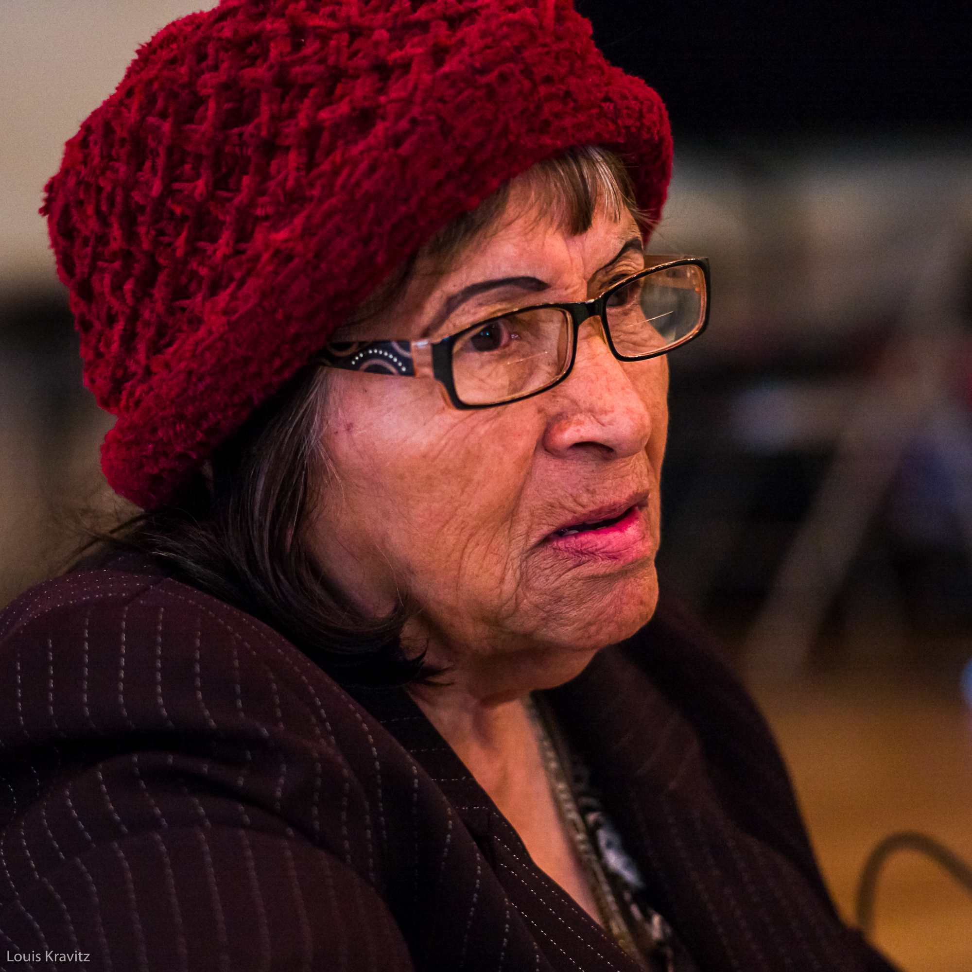 senior woman with crocheted hat and glasses