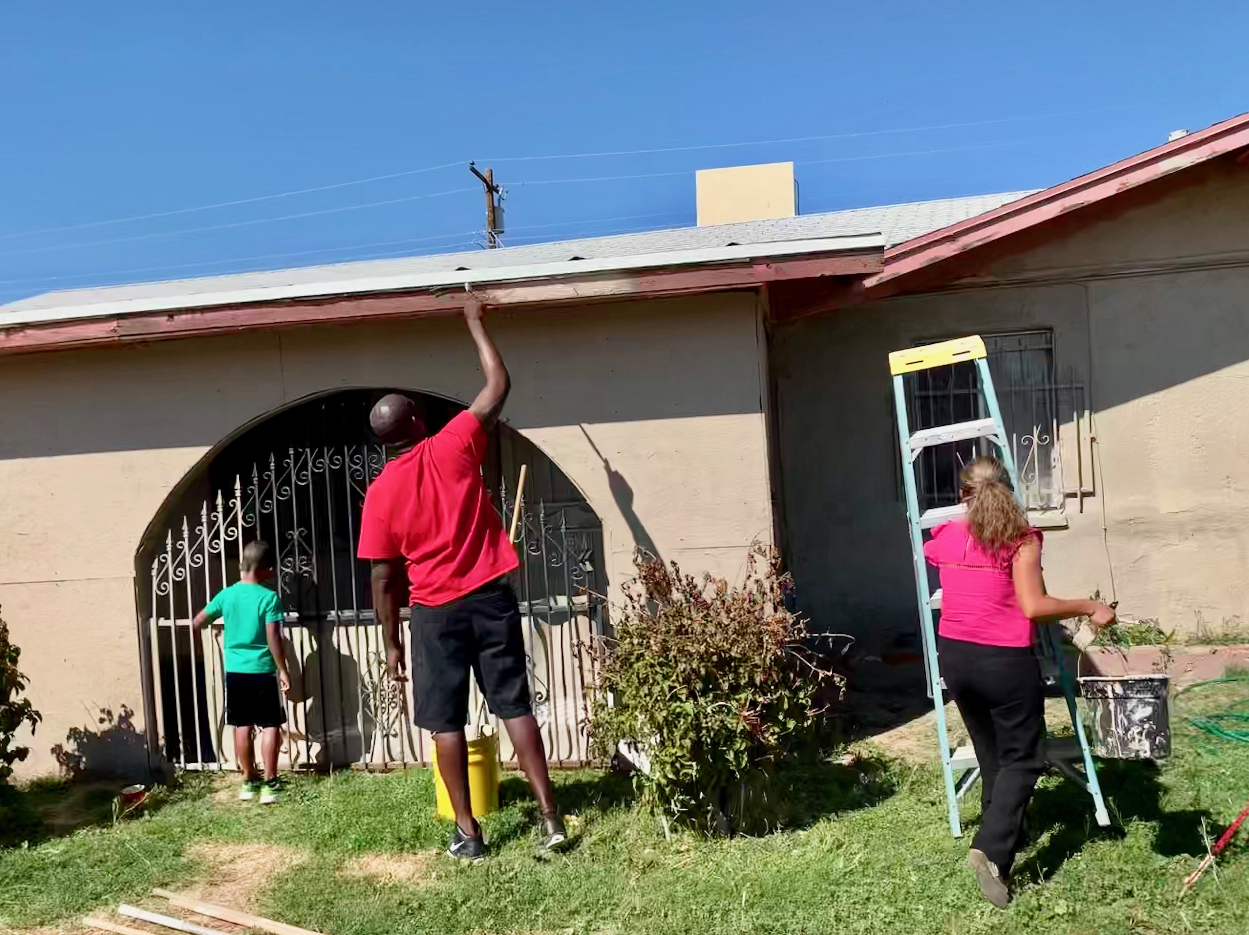 Painting grandma Lexi's house. Great pic of our volunteers!