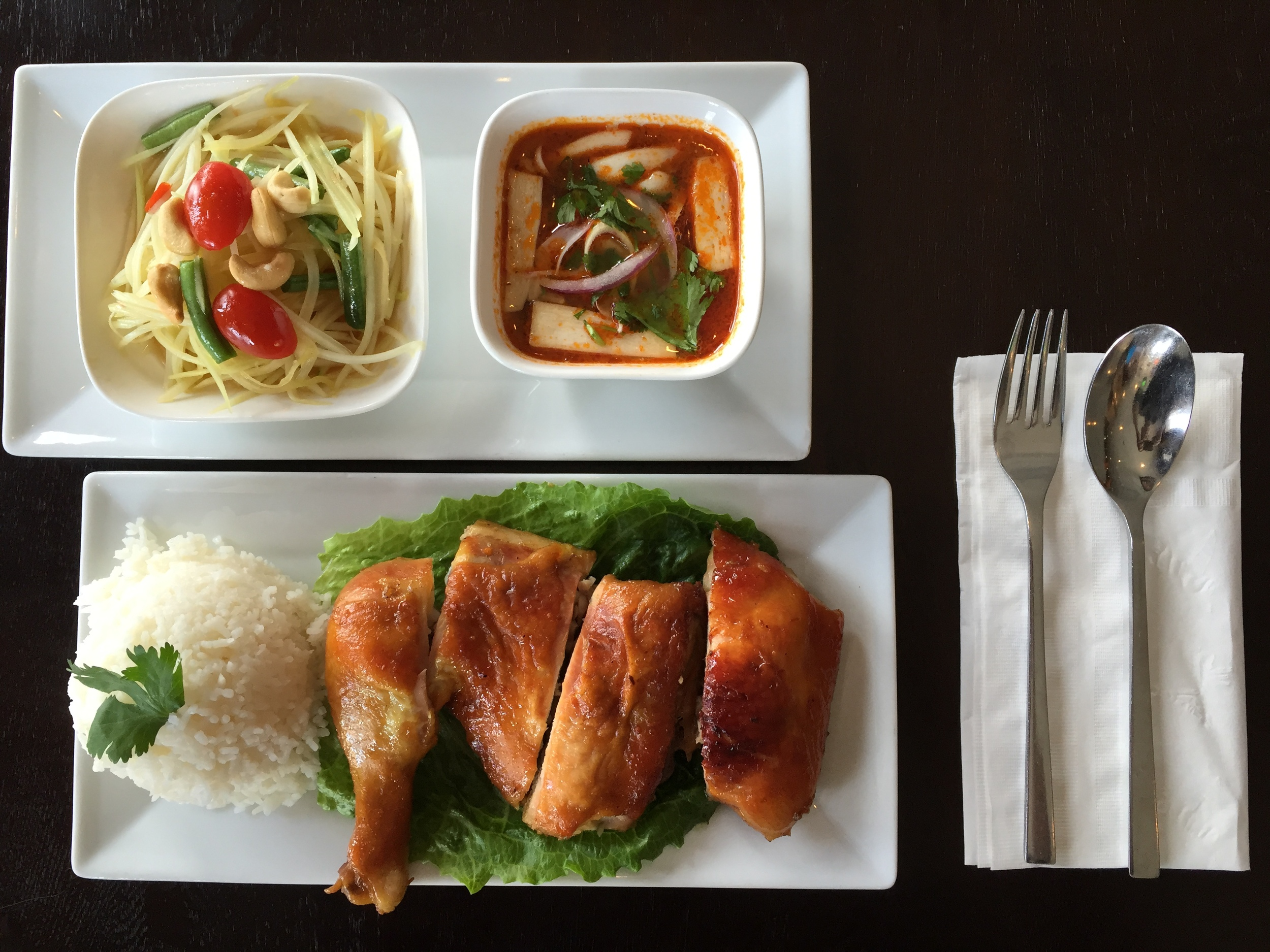 Green Papaya Salad and Shrimp Lemongrass Soup as Appetizers, along with very flavorful Thai BBQ Chicken and Jasmine rice. All together for $10.