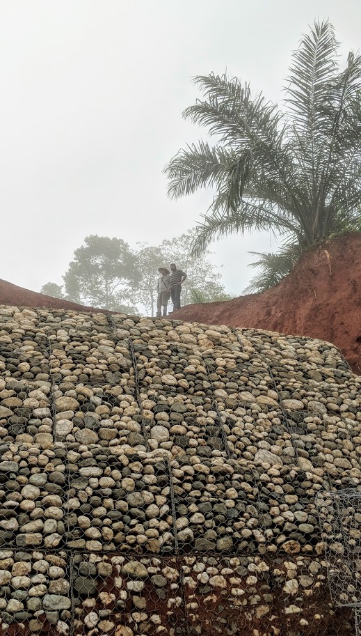 The rain, the fog...and a wall that looks like it was built by the Aztecs....we're getting there....