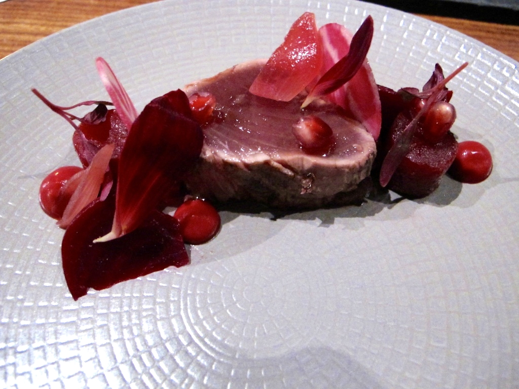 Bonito with pomegranate, beets, pink peppercorns, Meyer lemon, and hibiscus petals grilled tataki style